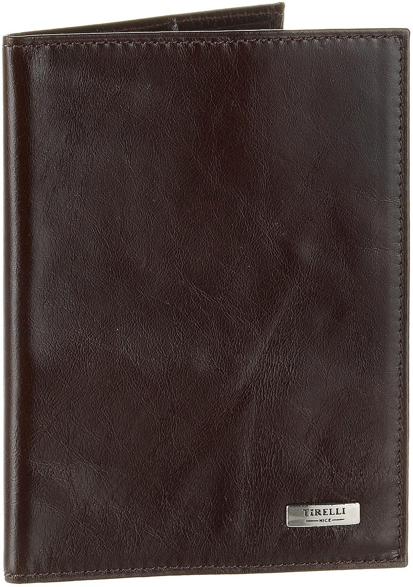 Обложка для паспорта Tirelli Мелоди, с кожаными карманами, цвет: коричневый. 15-317-10W16-11128_323Обложка для паспорта Tirelli Мелоди изготовлена из натуральной кожи коричневого цвета с матовой текстурой.Внутри два вертикальных кожаных кармана. Такая обложка не только поможет сохранить внешний вид ваших документов и защитит их от повреждений, но и станет ярким аксессуаром, который подчеркнет ваш образ. Изделие упаковано в подарочную коробку синего цвета с логотипом фирмы Tirelli. Характеристики:Материал: натуральная кожа, текстиль. Цвет: коричневый. Размер обложки (в сложенном виде): 13,5 см х 9,5 см. Размер упаковки: 15,5 см х 11,5 см х 2,5 см. Артикул: 15-317-10.