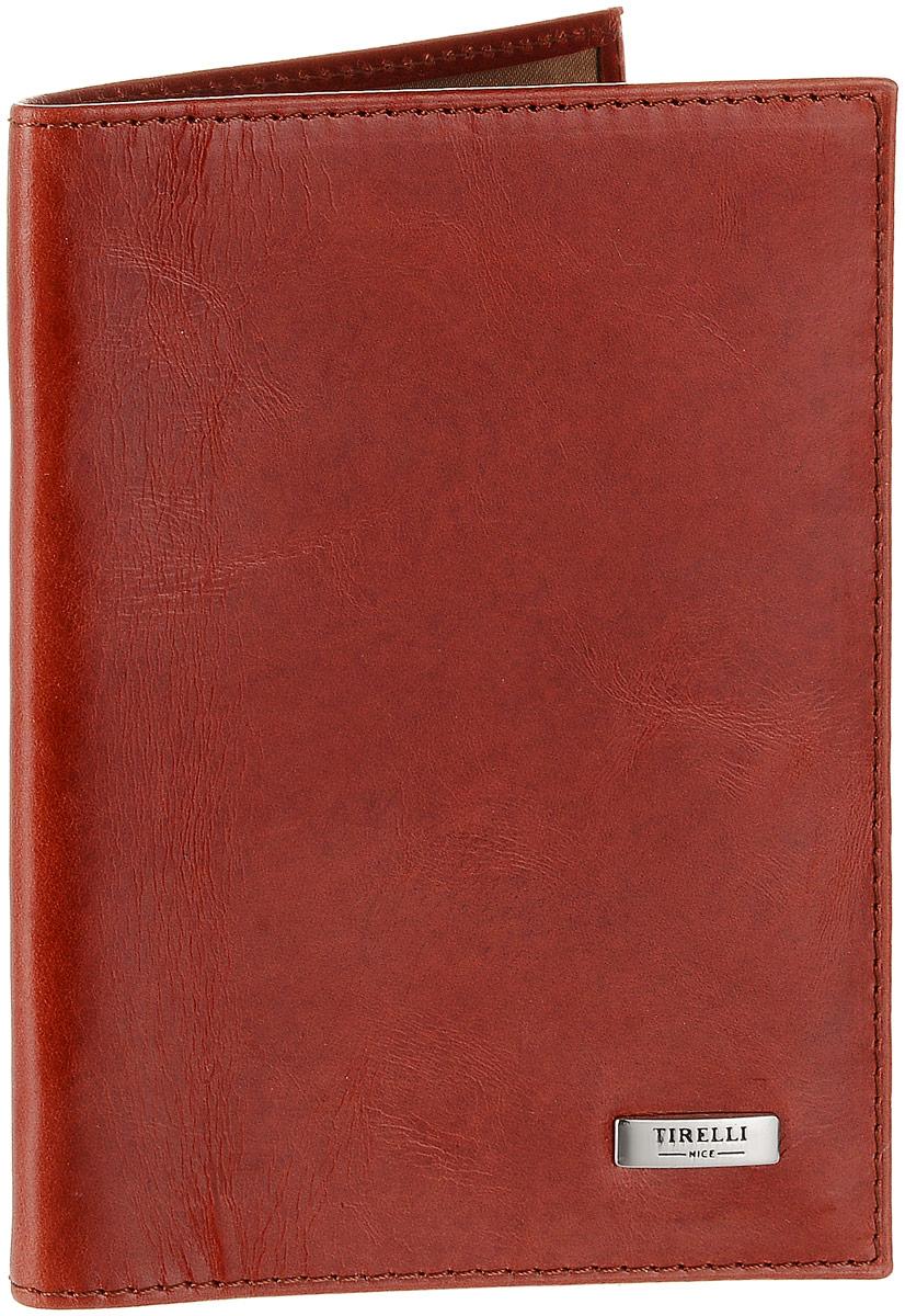 Обложка для паспорта женская Tirelli, цвет: красно-оранжевый. 15-333-25O.88.BR.синийЖенская обложка для паспорта Tirelli выполнена из натуральной кожи. Внутри расположены боковые прозрачные карманы из пластика для фиксации паспорта. Изделие упаковано в фирменную коробку. Такая обложка не только поможет сохранить внешний вид ваших документов, но и станет стильным аксессуаром, идеально подходящим вашему образу.
