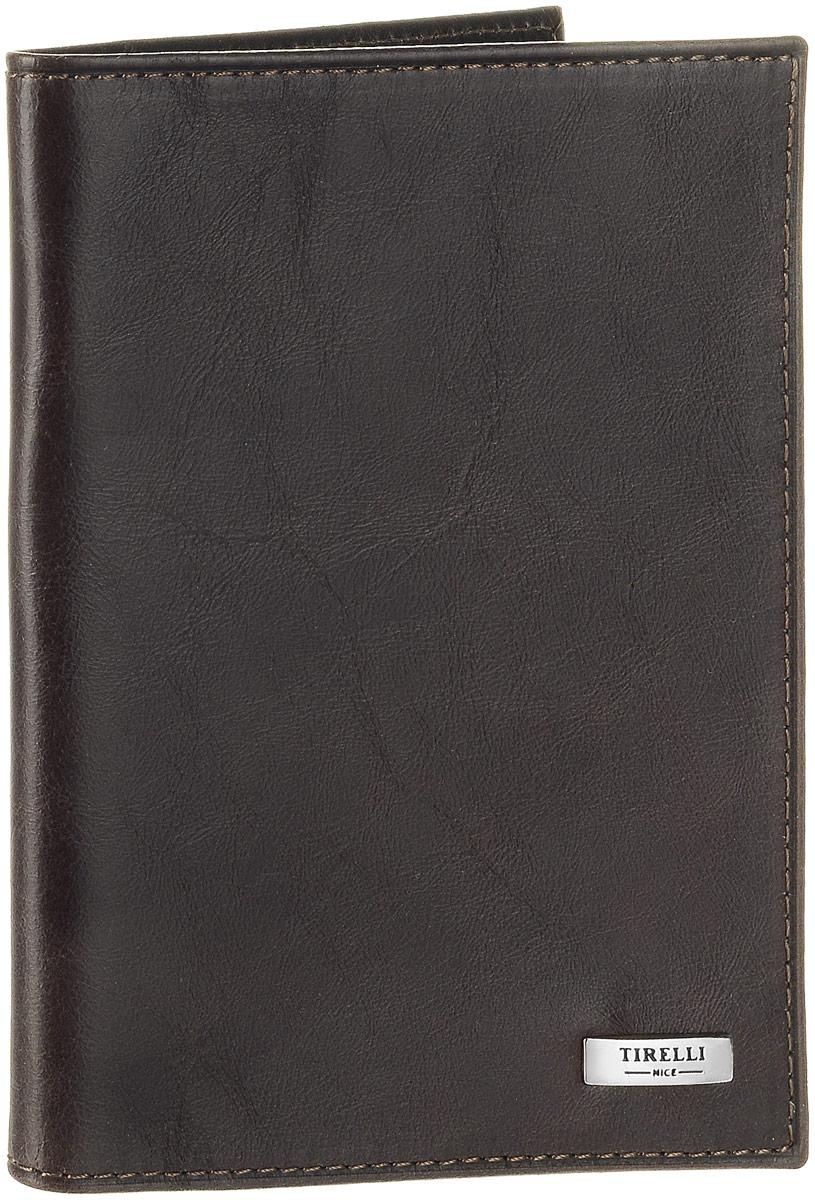 Обложка для паспорта Tirelli Денвер, цвет: коричневый. 15-333-12INT-06501Обложка для паспорта Tirelli Денвер изготовлена из натуральной кожи коричневого цвета с матовой текстурой. Внутри два вертикальных кармана из прозрачного пластика. Такая обложка не только поможет сохранить внешний вид ваших документов и защитит их от повреждений, но и станет ярким аксессуаром, который подчеркнет ваш образ. Изделие упаковано в подарочную коробку синего цвета с логотипом фирмы Tirelli. Характеристики:Материал: натуральная кожа, текстиль, пластик. Цвет: коричневый. Размер обложки (в сложенном виде): 13,5 см х 9,5 см.