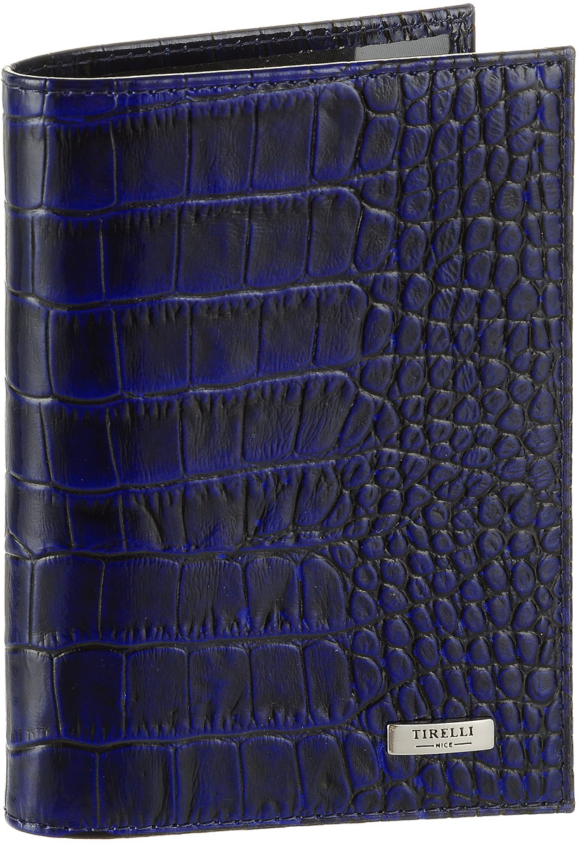 Обложка для паспорта женская Tirelli Кроко, цвет: темно-синий. 15-333-1515-333-15Женская обложка для паспорта Tirelli Кроко, выполненная из натуральной лакированной кожи, оформлена тиснением под рептилию. Внутри расположены боковые прозрачные карманы из пластика для фиксации паспорта. Изделие упаковано в фирменную коробку. Такая обложка не только поможет сохранить внешний вид ваших документов, но и станет стильным аксессуаром, идеально подходящим вашему образу.