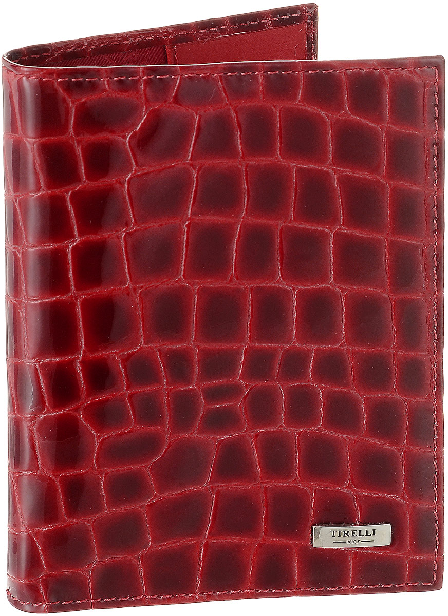 Обложка для паспорта женская Tirelli Санта Моника, цвет: красный. 15-317-1315-317-13Женская обложка для паспорта Tirelli Санта Моника, выполненная из натуральной лакированной кожи, оформлена тиснением под рептилию. Внутри расположены боковые карманы для фиксации паспорта. Изделие упаковано в фирменную коробку. Такая обложка не только поможет сохранить внешний вид ваших документов, но и станет стильным аксессуаром, идеально подходящим вашему образу.