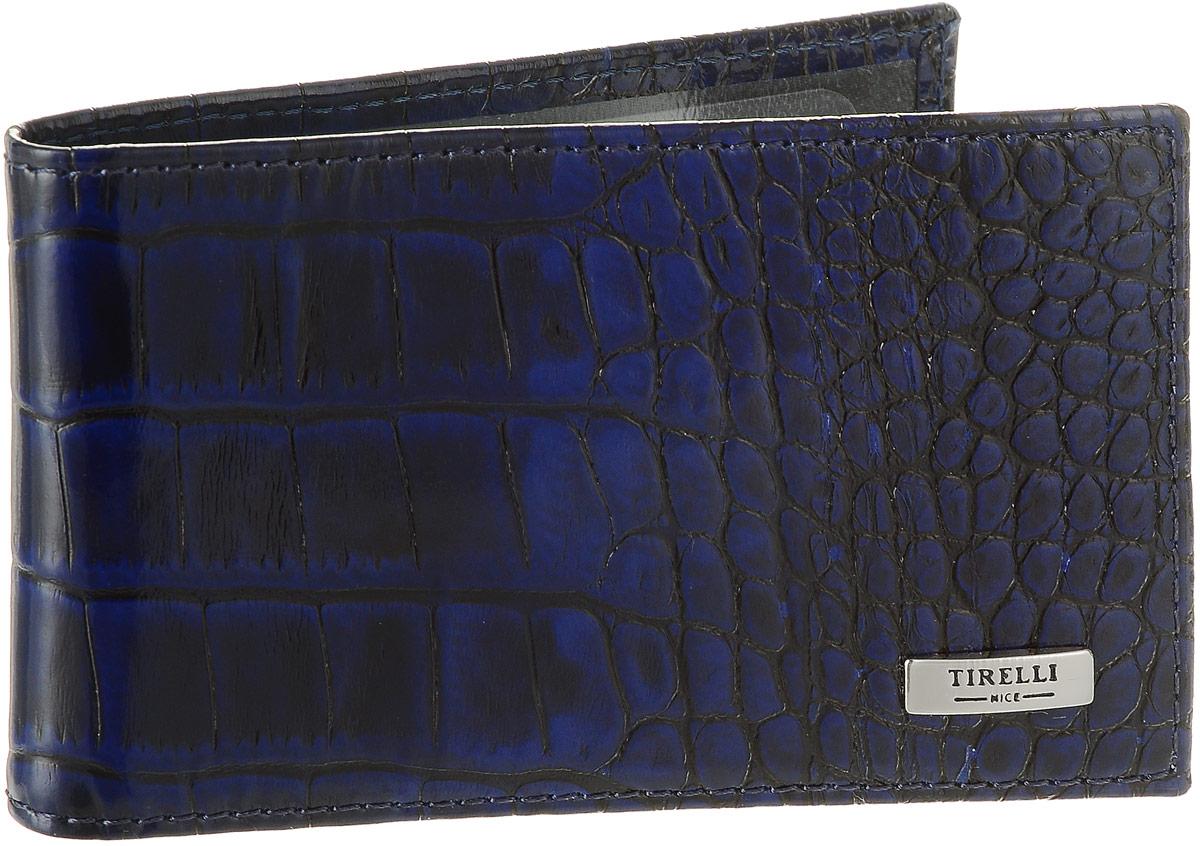Футляр для карточек Tirelli Кроко, цвет: синий. 15-325-15A52_108Футляр для карточек Tirelli Кроко изготовлен из натуральной кожи синего цвета с декоративным теснением под рептилию. Футляр оформлен фирменным логотипом. Внутри имеется 12 кармашков из прозрачного пластика для хранения пластиковых карт, визиток, дисконтных карт и т. п. Такой футляр не только поможет сохранить внешний вид ваших документов и защитит их от повреждений, но и станет ярким аксессуаром, который подчеркнет ваш образ. Изделие упаковано в подарочную коробку синего цвета с логотипом фирмы Tirelli. Характеристики:Материал: натуральная кожа, текстиль, пластик. Цвет: синий. Размер футляра (в сложенном виде): 11 см х 6,5 см.