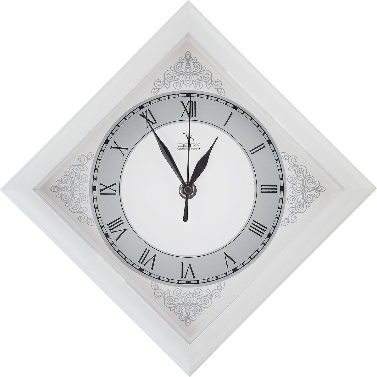 Часы настенные Вега Узоры, 20,6 х 20,6 х 4 смП1-9/6-186Настенные кварцевые часы Вега Узоры в классическом дизайне, изготовленные из пластика, прекрасно впишутся в интерьер вашего дома. Часы имеют три стрелки: часовую, минутную и секундную, циферблат защищен прозрачным пластиком. Часы работают от 1 батарейки типа АА напряжением 1,5 В (не входит в комплект).