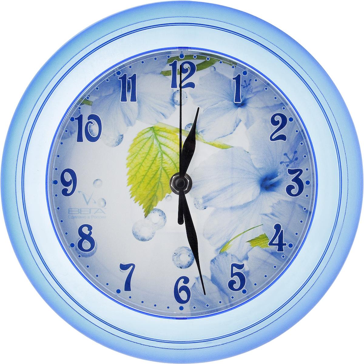 Часы настенные Вега Листок, диаметр 22,5 смП3-7-115Настенные кварцевые часы Вега Листок в классическом дизайне, изготовленные из пластика, прекрасно впишутся в интерьер вашего дома. Круглые часы имеют три стрелки: часовую, минутную и секундную, циферблат защищен прозрачным стеклом. Часы работают от 1 батарейки типа АА напряжением 1,5 В (не входит в комплект). Диаметр часов: 22,5 см.