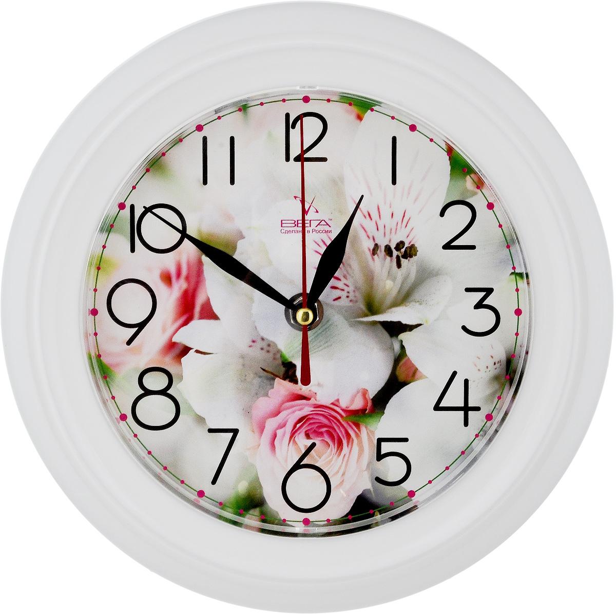 Часы настенные Вега Нежность, диаметр 22,5 смП3-791-12Настенные кварцевые часы Вега Нежность в классическом дизайне, изготовленные из пластика, прекрасно впишутся в интерьер вашего дома. Круглые часы имеют три стрелки: часовую, минутную и секундную, циферблат защищен прозрачным стеклом. Часы работают от 1 батарейки типа АА напряжением 1,5 В (не входит в комплект). Диаметр часов: 22,5 см.