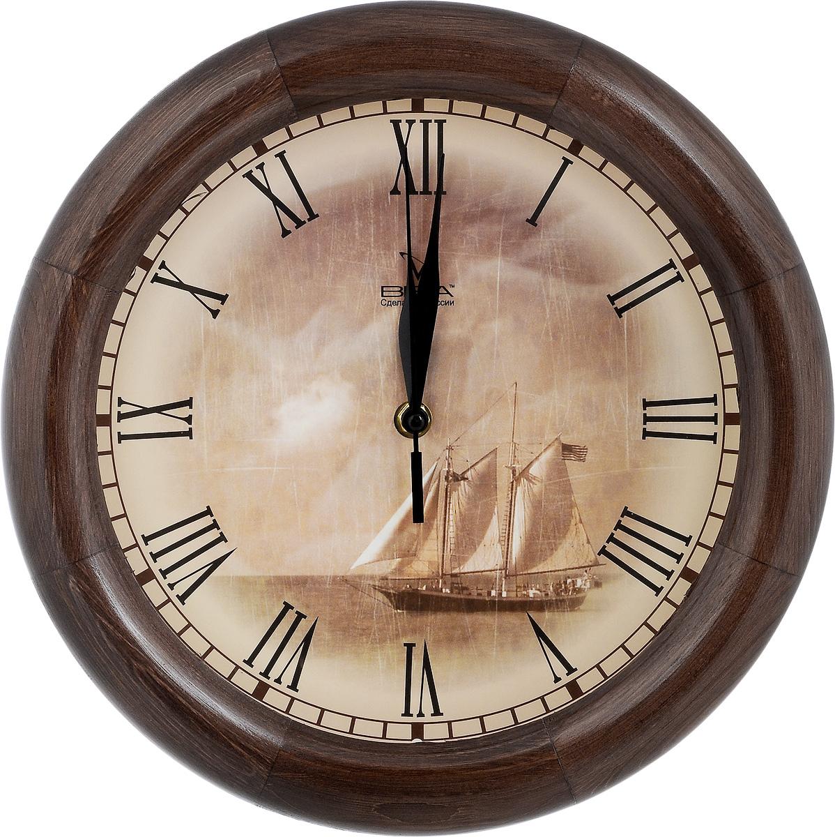 Часы настенные Вега Парусник, диаметр 30 см94672Настенные кварцевые часы Вега Парусник, изготовленные из дерева, прекрасно впишутся в интерьер вашего дома. Часы имеют три стрелки: часовую, минутную и секундную, циферблат защищен прозрачным стеклом. Часы работают от 1 батарейки типа АА напряжением 1,5 В (не входит в комплект).Диаметр часов: 30 см.