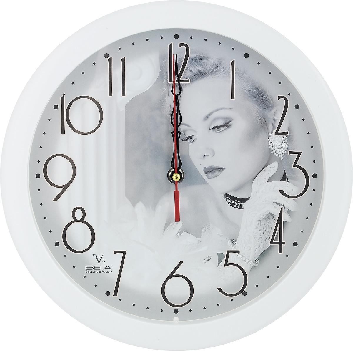 Часы настенные Вега Актриса, диаметр 28,5 см94672Настенные кварцевые часы Вега Актриса, изготовленные из пластика, прекрасно впишутся в интерьер вашего дома. Круглые часы имеют три стрелки: часовую, минутную и секундную, циферблат защищен прозрачным стеклом. Часы работают от 1 батарейки типа АА напряжением 1,5 В (не входит в комплект). Диаметр часов: 28,5 см.