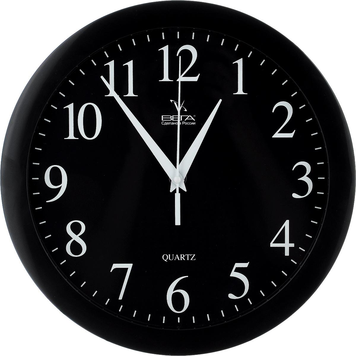 Часы настенные Вега Классика, цвет: черный, диаметр 28,5 см. П1-6300074_ежевикаНастенные кварцевые часы Вега Классика, изготовленные из пластика, прекрасно впишутся в интерьер вашего дома. Круглые часы имеют три стрелки: часовую, минутную и секундную, циферблат защищен прозрачным стеклом. Часы работают от 1 батарейки типа АА напряжением 1,5 В (не входит в комплект). Диаметр часов: 28,5 см.