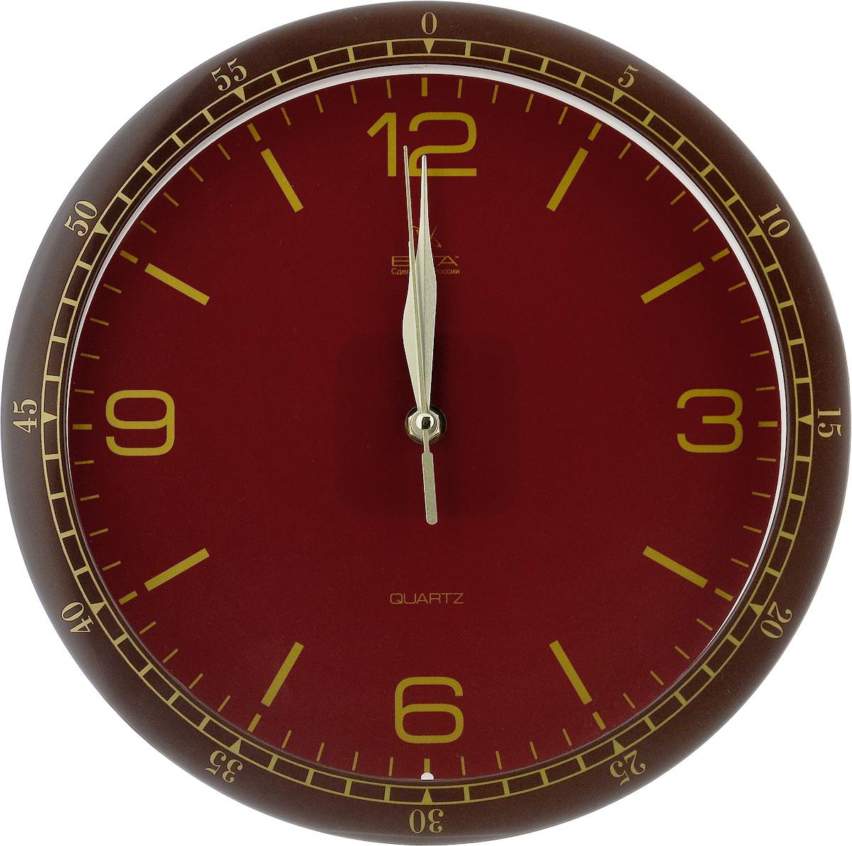 Часы настенные Вега Классика, цвет: коричневый, бордовый, золотой, диаметр 28,5 смП1-7/7-214Настенные кварцевые часы Вега Классика, изготовленные из пластика, прекрасно впишутся в интерьер вашего дома. Круглые часы имеют три стрелки: часовую, минутную и секундную, циферблат защищен прозрачным стеклом. Часы работают от 1 батарейки типа АА напряжением 1,5 В (не входит в комплект). Диаметр часов: 28,5 см.