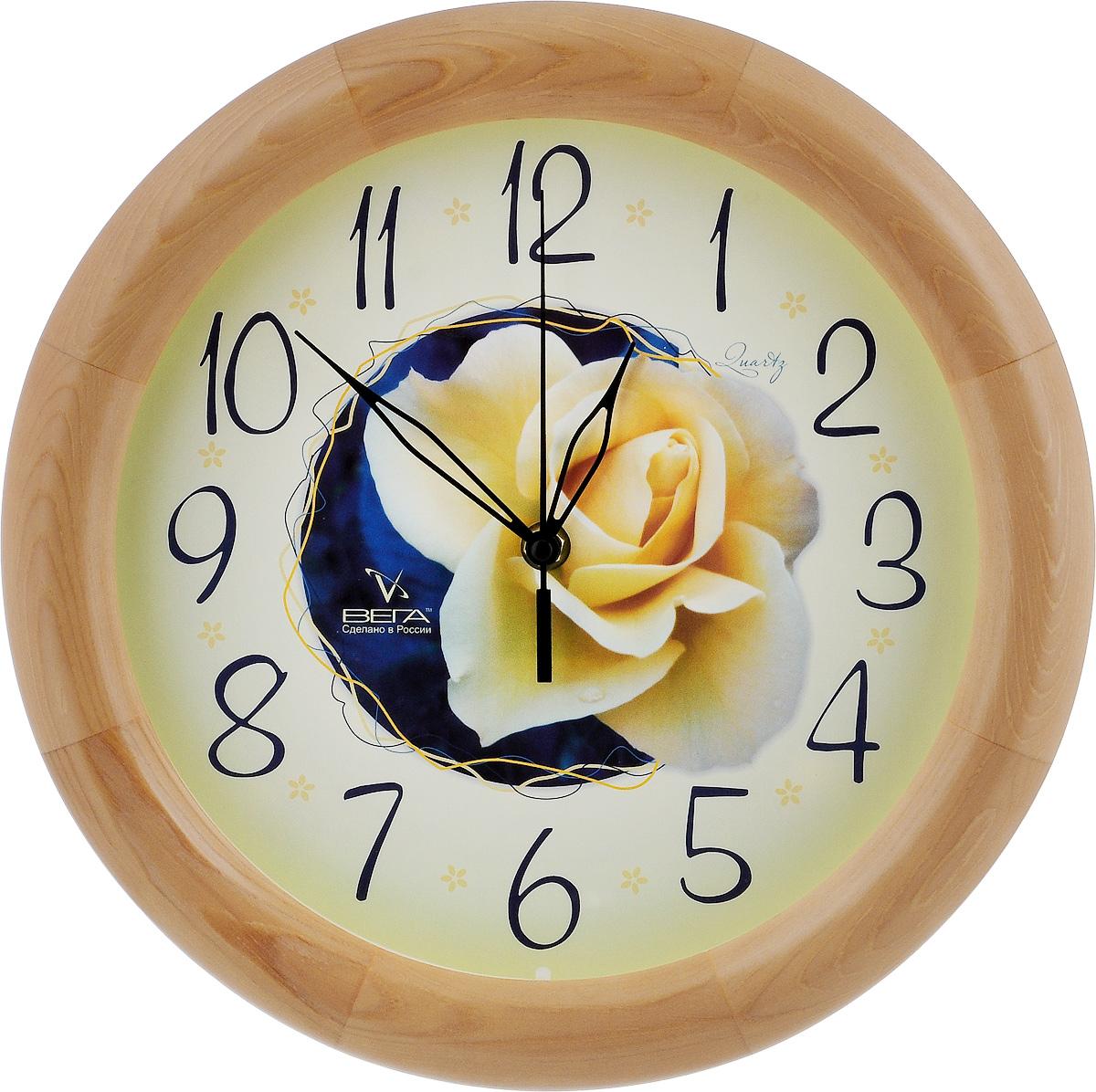 Часы настенные Вега Роза, диаметр 30 см59374Настенные кварцевые часы Вега Роза, изготовленные из дерева, прекрасно впишутся в интерьер вашего дома. Часы имеют три стрелки: часовую, минутную и секундную, циферблат защищен прозрачным стеклом. Часы работают от 1 батарейки типа АА напряжением 1,5 В (не входит в комплект).Диаметр часов: 30 см.