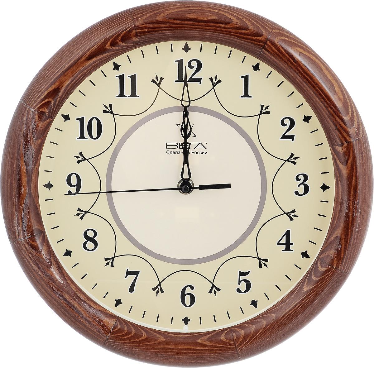 Часы настенные Вега Классика, диаметр 30 см. Д1КД/7TL-C5011Настенные кварцевые часы Вега Классика, изготовленные из дерева, прекрасно впишутся в интерьер вашего дома. Часы имеют три стрелки: часовую, минутную и секундную, циферблат защищен прозрачным стеклом. Часы работают от 1 батарейки типа АА напряжением 1,5 В (не входит в комплект).Диаметр часов: 30 см.