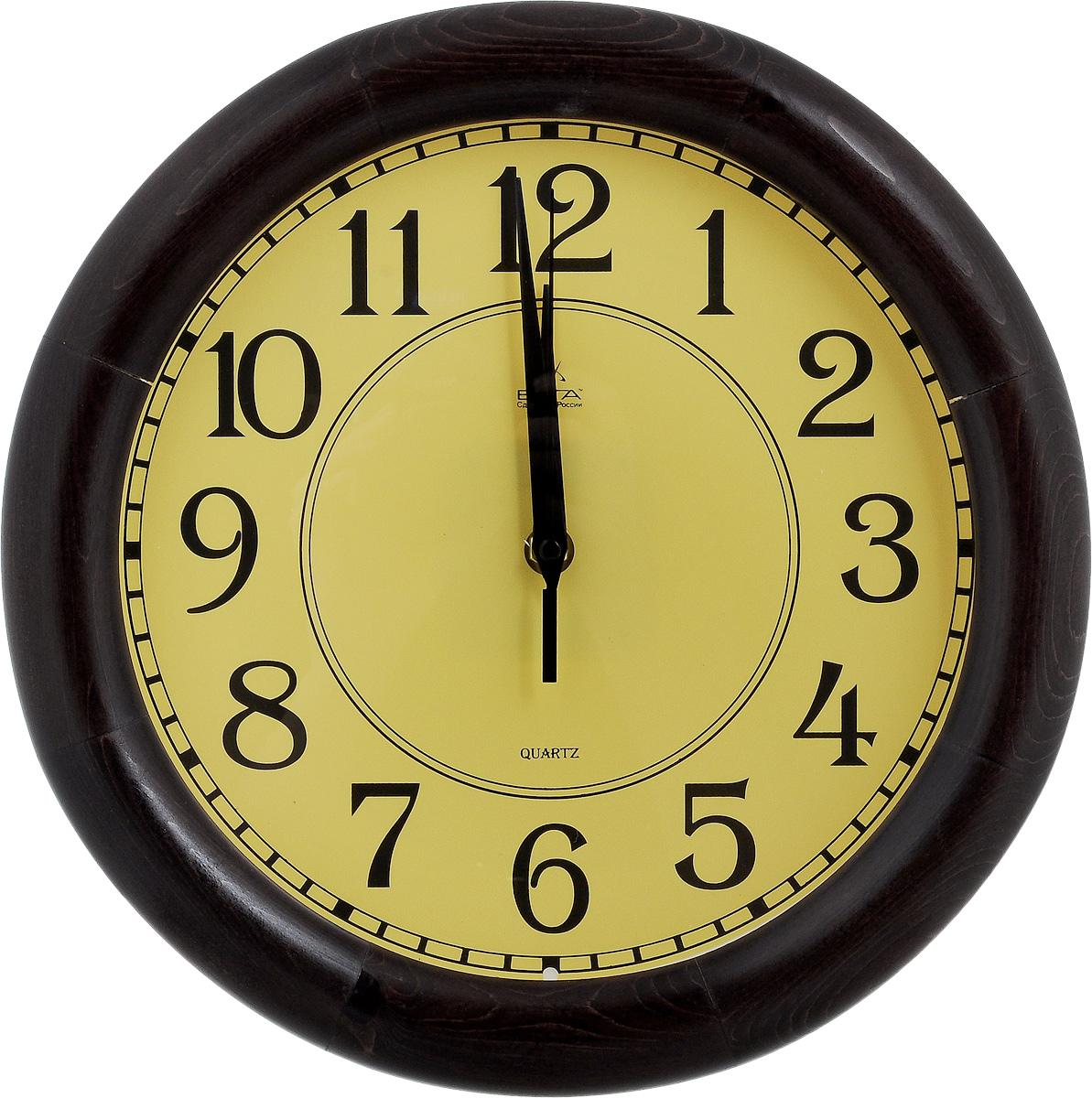Часы настенные Вега Классика, цвет: темно-коричневый, желтый, диаметр 30 см148126Настенные кварцевые часы Вега Классика, изготовленные из дерева, прекрасно впишутся в интерьер вашего дома. Часы имеют три стрелки: часовую, минутную и секундную, циферблат защищен прозрачным стеклом. Часы работают от 1 батарейки типа АА напряжением 1,5 В (не входит в комплект).Диаметр часов: 30 см.