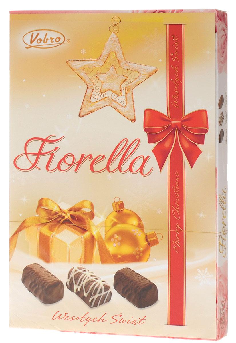 Vobro Fiorella Фиорелла набор шоколадных конфет, 140 г4009900461405Fiorella - это 3 дополнительных вкуса, создающих набор, который не надоест. Под деликатным шоколадом скрыт вкус кокоса, ореха и капучино. Такой набор, несомненно, порадует каждую женщину.Уважаемые клиенты! Обращаем ваше внимание, что полный перечень состава продукта представлен на дополнительном изображении.