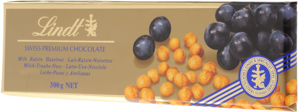 Lindt Gold молочный шоколад с изюмом и цельным фундуком, 300 г0120710Шоколадная плитка большого формата Swiss Premium из молочного шоколада с цельным фундуком и изюмом создана по традиционному швейцарскому рецепту Мэтрами Шоколатье Lindt с 1845 года.Уважаемые клиенты! Обращаем ваше внимание, что полный перечень состава продукта представлен на дополнительном изображении.