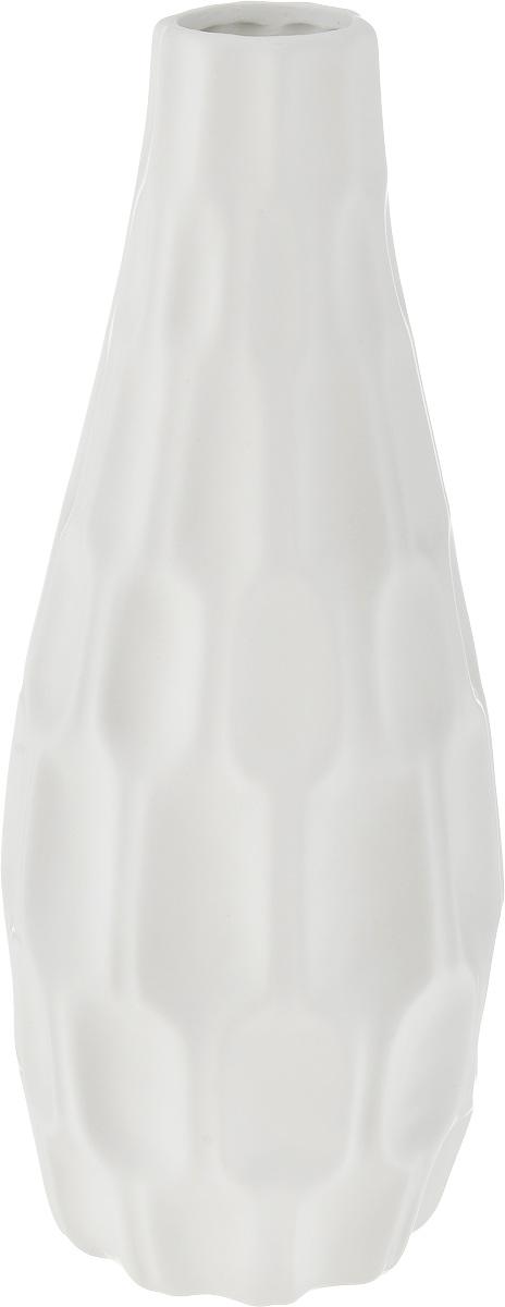 Ваза декоративная Феникс-Презент, высота 30,5 см. 43828xx004-98Оригинальная ваза Феникс-Презент изготовлена из фаянса. Рельефная поверхностью вазы делает ее изящным украшением интерьера. При желании изделие можно оформить по собственному вкусу, например раскрасив его красками. Ваза Феникс-Презент дополнит интерьер офиса или дома и станет желанным и стильным подарком.Диаметр вазы по верхнему краю: 4 см.Диаметр дна: 9 см. Высота вазы: 30,5 см.