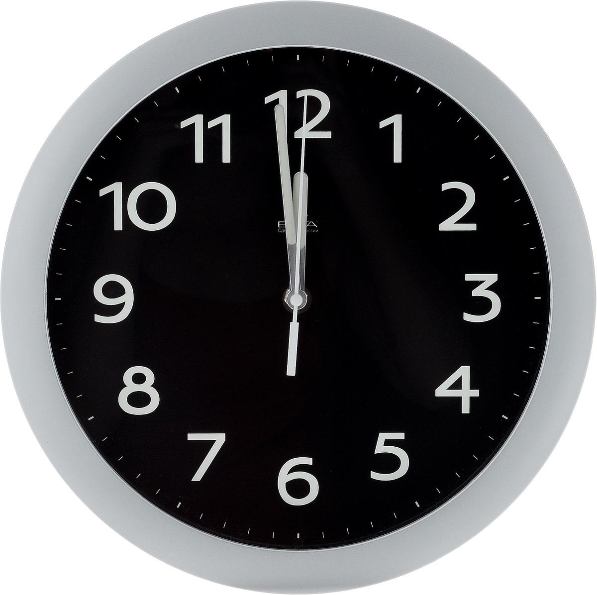 Часы настенные Вега Фосфор, диаметр 28,5 см94672Настенные кварцевые часы Вега Фосфор, изготовленные из пластика, прекрасно впишутся в интерьер вашего дома. Круглые часы имеют три стрелки: часовую, минутную и секундную, циферблат защищен прозрачным стеклом. Часы работают от 1 батарейки типа АА напряжением 1,5 В (не входит в комплект). Диаметр часов: 28,5 см.