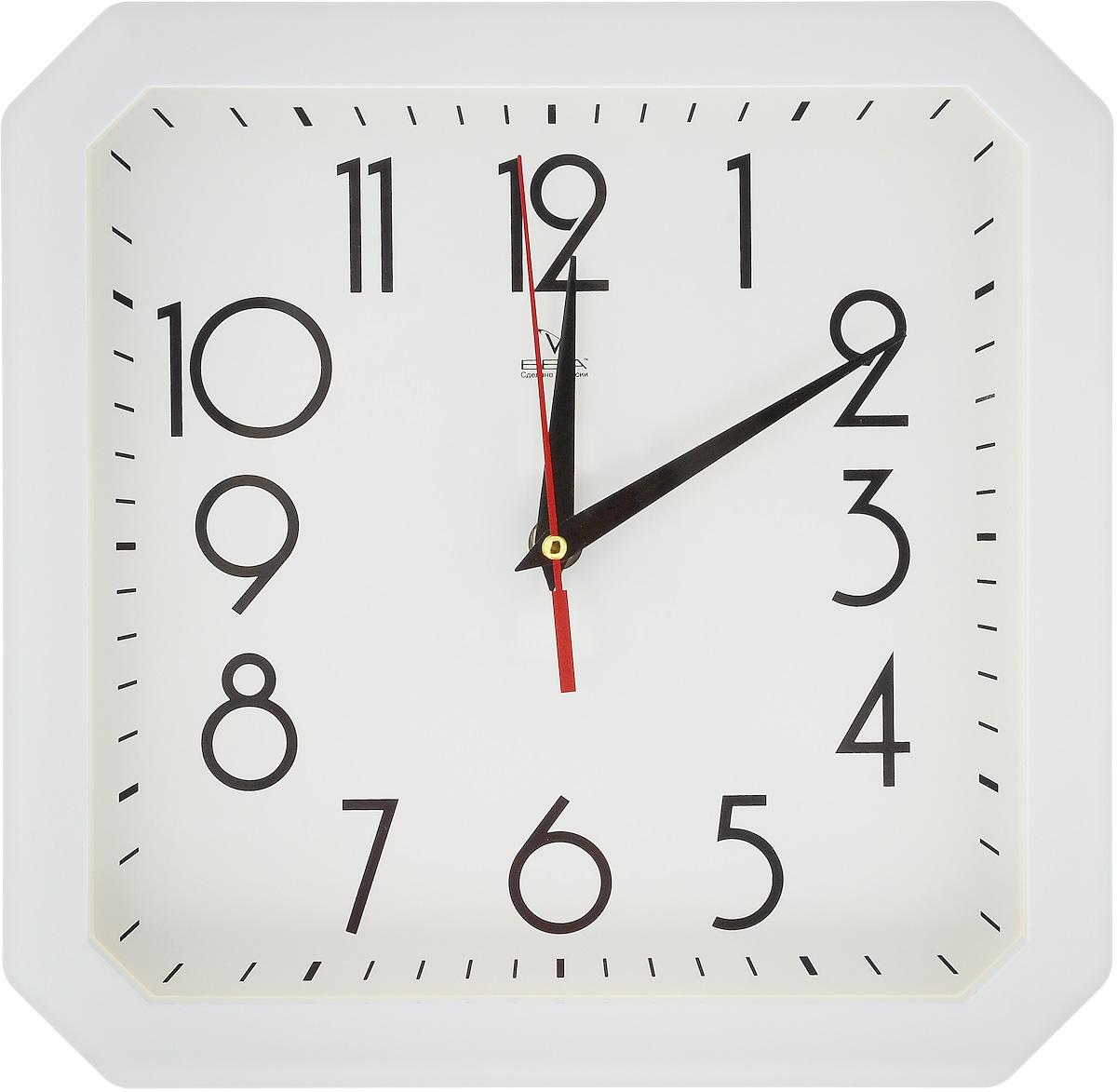 Часы настенные Вега Классика, цвет: белый, 28 х 28 смП1-6/6-45Настенные кварцевые часы Вега Классика, изготовленные из пластика, прекрасно впишутся в интерьер вашего дома. Часы имеют три стрелки: часовую, минутную и секундную, циферблат защищен прозрачным стеклом. Часы работают от 1 батарейки типа АА напряжением 1,5 В (не входит в комплект).Размер часов: 28 х 28 х 4 см.