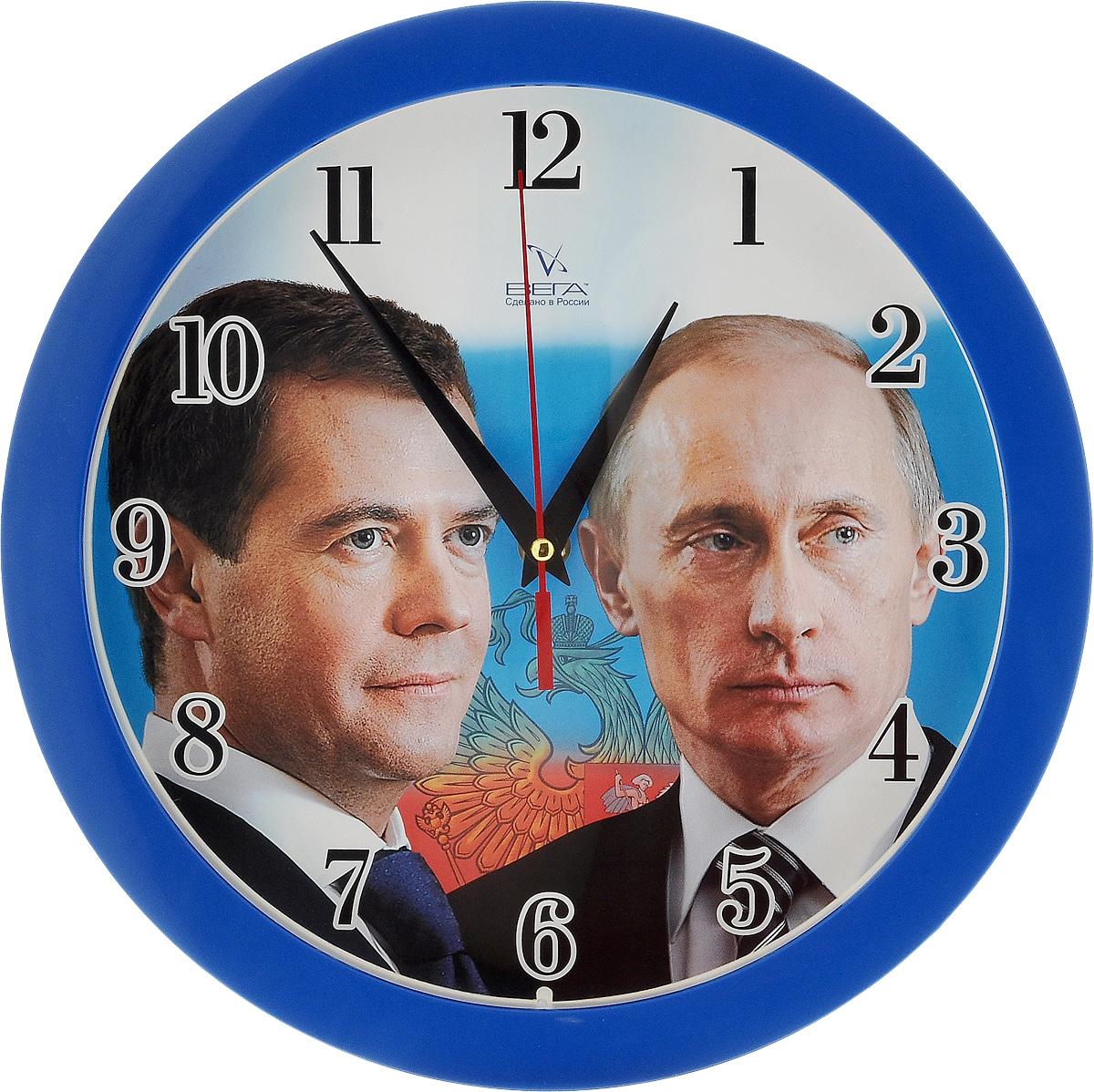 Часы настенные Вега Первые лица, диаметр 28,5 смД1МД/6-191Настенные кварцевые часы Вега Первые лица, изготовленные из пластика, прекрасно впишутся в интерьер вашего дома. Круглые часы имеют три стрелки: часовую, минутную и секундную, циферблат защищен прозрачным стеклом. Часы работают от 1 батарейки типа АА напряжением 1,5 В (не входит в комплект). Диаметр часов: 28,5 см.