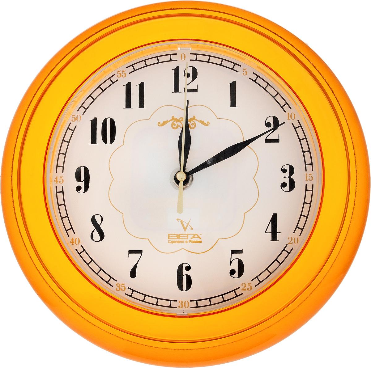 Часы настенные Вега Классика, цвет: оранжевый, диаметр 22 смП1-2/7-11Настенные кварцевые часы Вега Классика, изготовленные из пластика, прекрасно впишутся в интерьер вашего дома. Круглые часы имеют три стрелки: часовую, минутную и секундную, циферблат защищен прозрачным стеклом. Часы работают от 1 батарейки типа АА напряжением 1,5 В (не входит в комплект). Диаметр часов: 22 см.