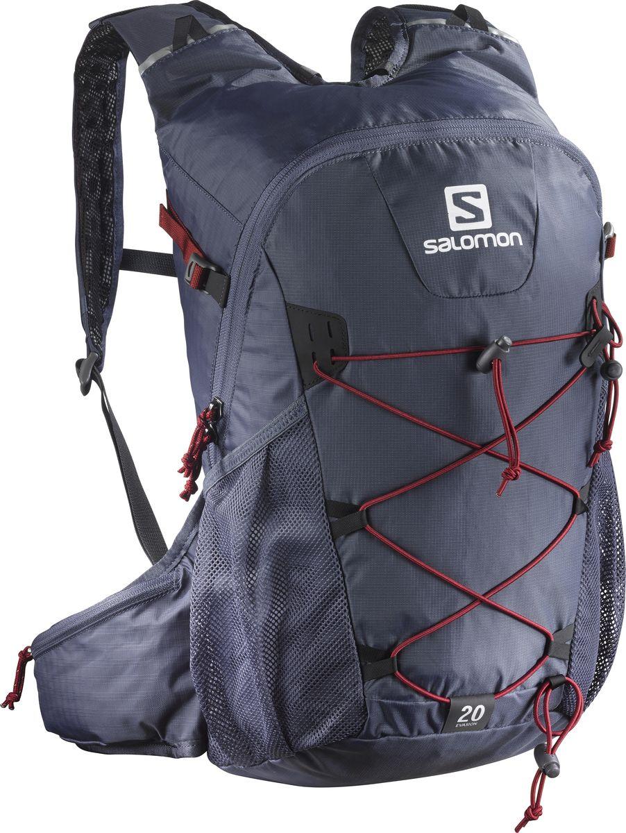 Рюкзак спортивный Salomon Evasion 20, цвет: серый, 20 л. L39323800ГризлиРюкзак Salomon Evasion 20 выполнен из высококачественного полиамида и полиэстера. Рюкзак имеет одно вместительное отделение и закрывается на застежку-молнию. Рюкзак оснащен мягкими удобными лямками, длина которых регулируется с помощью пряжек. На внешней стороне расположены два открытых кармана-сетки. Устойчивый и комфортный рюкзак Evasion 20 имеет фиксаторы для палок и другого снаряжения, необходимого во время однодневного похода.