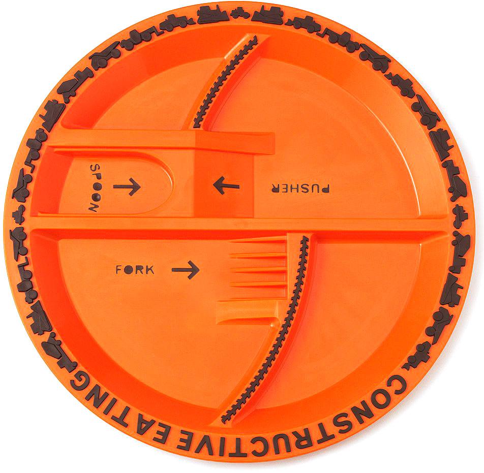 Constructive Eating Тарелка детская ConstructionVT-1520(SR)Зонированая тарелка Construction бренда Constructive Eating, занимающегося созданием развивающей посуды для детей. Входит в Строительную серию, разработанную специально для мальчиков. Уменьшенные образцы строительной техники, использованные для украшения кромки тарелки, являются резными, не отделяются и не снимаются - ребенок их не проглотит. Производится в США из качественных материалов, одобренных Управлением по санитарному надзору за качеством пищевых продуктов и медикаментов США. Может использоваться в микроволновке и посудомоечной машине.