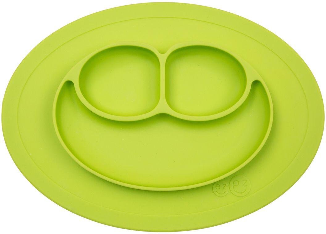 Ezpz Тарелка детская Mini Mat цвет зеленыйPCMMG001Ezpz Mini Mat - уменьшенная версия тарелочки-плейсмата Happy Mat. Предназначена для столиков для кормления и использования в поездках. Рекомендована для малышей от 4 месяцев. Тарелка тоньше, легче и компактнее, чем Happy Mat, но обладает теми же отличительными чертами: присасывается к столу, чтобы ребенок не смог ее перевернуть; подходит для микроволновки и посудомоечной машины; улыбается и вызывает у детей улыбку. Вмещает 240 мл. У тарелочки также есть удобный чехольчик с ручками, который легко можно взять с собой.Тарелка разработана и запатентована в США. Идея создания удобной безопасной посуды для детей принадлежит многодетной маме, которая как никто другой знает, как сложно уследить за детками во время еды и сохранить при этом чистоту и порядок. Благодаря такой тарелочке прием пищи становится веселым и безопасным, а кухня остается чистой и опрятной.