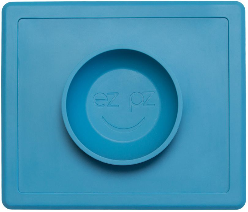 Ezpz Тарелка детская Happy Bowl цвет голубой115510Ezpz Happy Bowl - силиконовая тарелка-плейсмат, которую невозможно перевернуть. Чаша высотой почти 4 см и объемом 240 мл идеально подходит для завтраков и обедов. Область плейсмата не дает ребенку испачкать стол. Тарелка изготовлена из силикона высочайшего качества и абсолютно безопасна. Не имеет липучек или присосок - фиксация происходит на любой ровной горизонтальной поверхности за счет плоской, гладкой поверхности тарелочки - мата. Подходит для использования в микроволновке и посудомоечной машине. Выглядит как улыбающаяся рожица, что очень нравится детям и их мамам. Тарелка разработана и запатентована в США. Идея создания удобной, безопасной посуды для детей принадлежит многодетной маме, которая как никто другой знает, как сложно уследить за детками во время еды и сохранить при этом чистоту и порядок. Благодаря такой тарелочке прием пищи становится веселым и безопасным, а кухня остается чистой и опрятной.