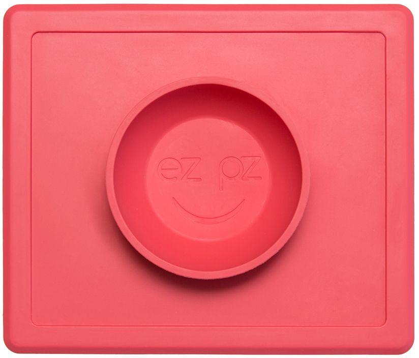 Ezpz Тарелка детская Happy Bowl цвет коралловыйPKHBC004Ezpz Happy Bowl - силиконовая тарелка-плейсмат, которую невозможно перевернуть. Чаша высотой почти 4 см и объемом 240 мл идеально подходит для завтраков и обедов. Область плейсмата не дает ребенку испачкать стол. Тарелка изготовлена из силикона высочайшего качества и абсолютно безопасна. Не имеет липучек или присосок - фиксация происходит на любой ровной горизонтальной поверхности за счет плоской, гладкой поверхности тарелочки - мата. Подходит для использования в микроволновке и посудомоечной машине. Выглядит как улыбающаяся рожица, что очень нравится детям и их мамам. Тарелка разработана и запатентована в США. Идея создания удобной, безопасной посуды для детей принадлежит многодетной маме, которая как никто другой знает, как сложно уследить за детками во время еды и сохранить при этом чистоту и порядок. Благодаря такой тарелочке прием пищи становится веселым и безопасным, а кухня остается чистой и опрятной.