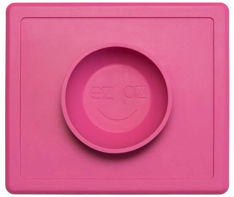 Ezpz Тарелка детская Happy Bowl цвет розовый54 009312Ezpz Happy Bowl - силиконовая тарелка-плейсмат, которую невозможно перевернуть. Чаша высотой почти 4 см и объемом 240 мл идеально подходит для завтраков и обедов. Область плейсмата не дает ребенку испачкать стол. Тарелка изготовлена из силикона высочайшего качества и абсолютно безопасна. Не имеет липучек или присосок - фиксация происходит на любой ровной горизонтальной поверхности за счет плоской, гладкой поверхности тарелочки - мата. Подходит для использования в микроволновке и посудомоечной машине. Выглядит как улыбающаяся рожица, что очень нравится детям и их мамам. Тарелка разработана и запатентована в США. Идея создания удобной, безопасной посуды для детей принадлежит многодетной маме, которая как никто другой знает, как сложно уследить за детками во время еды и сохранить при этом чистоту и порядок. Благодаря такой тарелочке прием пищи становится веселым и безопасным, а кухня остается чистой и опрятной.