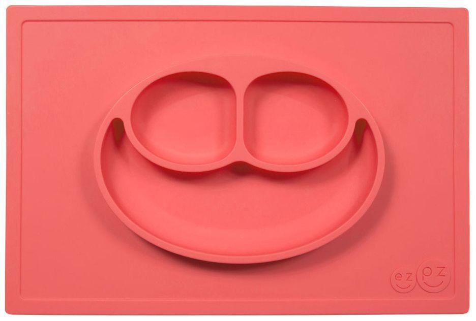 Ezpz Тарелка детская Happy Mat цвет коралловыйPKHMC004Ezpz Happy Mat - необычная силиконовая тарелка-плейсмат, которая не имеет аналогов. Ее главная особенность заключается в том, что тарелку невозможно перевернуть или опрокинуть. С ней ребенок не сможет испачкать стол или, что гораздо важнее, обжечься горячей пищей.Изготовлена из силикона высочайшего качества и абсолютно безопасна. Не имеет липучек или присосок - фиксация происходит на любой ровной горизонтальной поверхности за счет плоской, гладкой поверхности тарелочки - мата. Подходит для использования в микроволновке и посудомоечной машине. Выглядит как улыбающаяся рожица, что очень нравится детям и их мамам.Тарелка разработана и запатентована в США. Идея создания удобной, безопасной посуды для детей, принадлежит многодетной маме, которая как никто другой знает, как сложно уследить за детками во время еды и сохранить при этом чистоту и порядок. Благодаря такой тарелочке прием пищи становится веселым и безопасным, а кухня остается чистой и опрятной.Объем 540 мл.