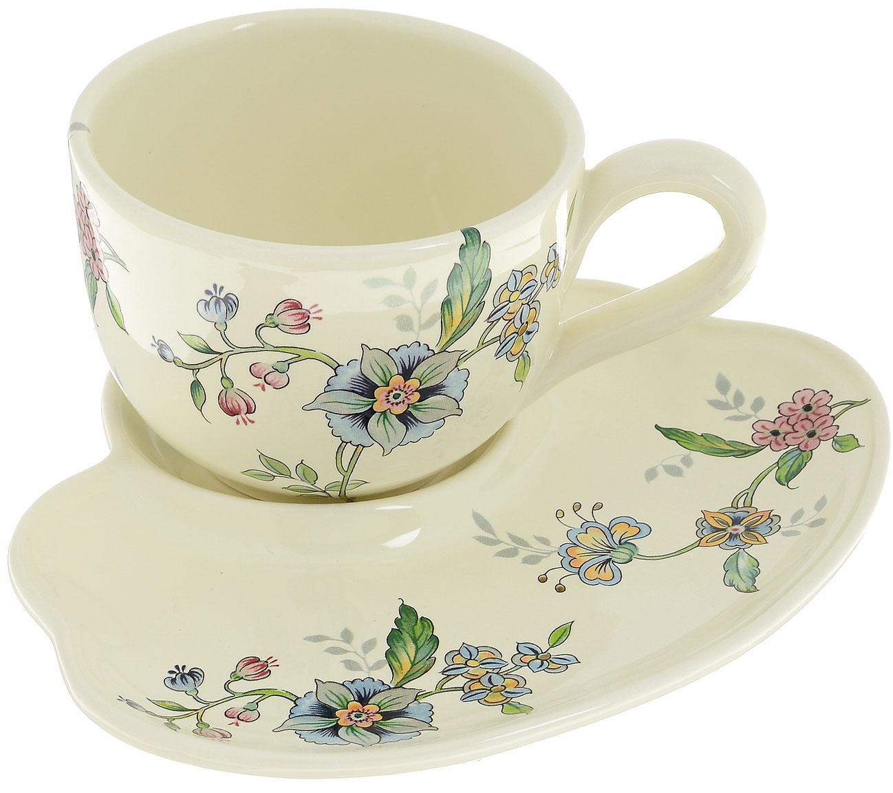 Набор для завтрака Nuova Cer Прованс, 2 предмета115510Набор для завтрака Nuova Cer Прованс состоит из чашки и тарелки, изготовленных из высококачественной керамики. Изделия оформлены цветочным узором. Красочность оформления придется по вкусу и ценителям классики, и тем, кто предпочитает утонченность и изысканность. Такой набор прекрасно дополнит сервировку стола к завтраку и подчеркнет ваш безупречный вкус.Набор для завтрака Nuova Cer Прованс - это прекрасный подарок к любому случаю. Изделия нельзя мыть в посудомоечной машине.Объем чашки: 600 мл.Диаметр чашки (по верхнему краю): 12 см.Высота чашки: 9 см.Размер тарелки: 20 х 23 см.
