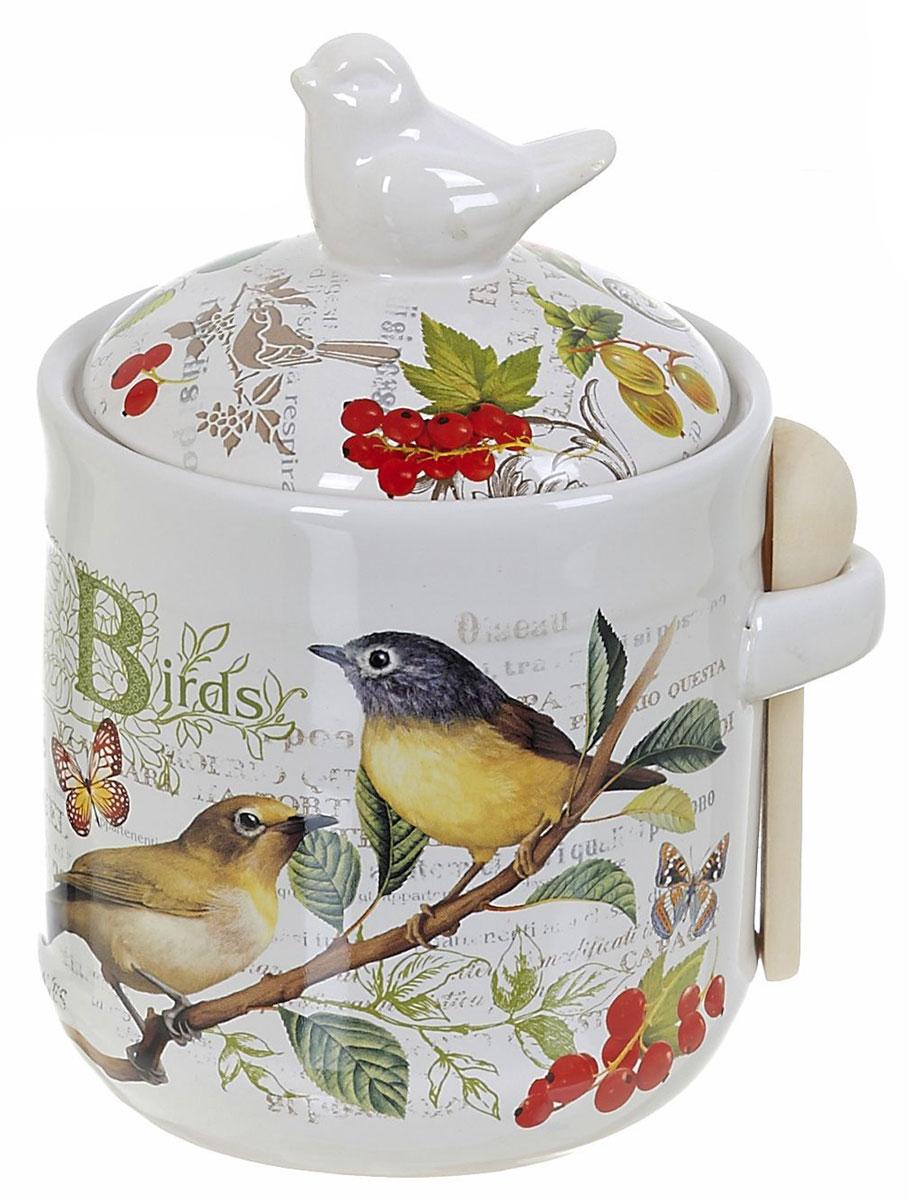 Банка для сыпучих продуктов Polystar Birds, с ложкой, 800 млVT-1520(SR)Банка для сыпучих продуктов изготовлена из прочной доломитовой керамики, покрытой слоем сверкающей гладкой глазури. Изделие оформлено красочным изображением. В комплект входит деревянная ложечка.Банка прекрасно подойдет для хранения различных сыпучих продуктов: чая, кофе, сахара, круп и многого другого.Изящная емкость не только поможет хранить разнообразные сыпучие продукты, но и стильно дополнит интерьер кухни.