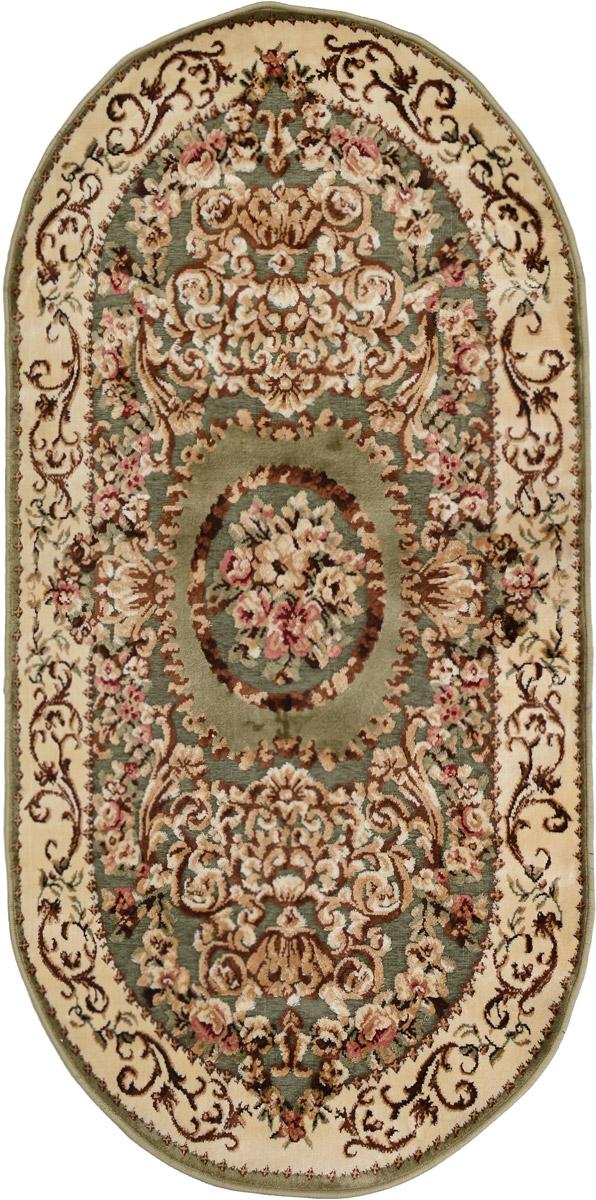 Ковер Mutas Carpet Silk Road, овальный, цвет: зеленый, бежевый, коричневый, 80 х 150 смES-412Ковер Mutas Carpet Silk Road изготовлен из прочного полипропилена. Полипропилен износостоек, нетоксичен, не впитывает влагу, не провоцирует аллергию. Структура волокна в полипропиленовых коврах гладкая, поэтому грязь не будет въедаться и скапливаться на ворсе. Практичный и износоустойчивый ворс не истирается и не накапливает статическое электричество. Ковер обладает хорошими показателями теплостойкости и шумоизоляции. Оригинальный рисунок позволит гармонично оформить интерьер комнаты, гостиной или прихожей. За счет невысокого ворса ковер легко чистить. При надлежащем уходе синтетический ковер прослужит долго, не утратив ни яркости узора, ни блеска ворса, ни упругости. Самый простой способ избавить изделие от грязи - пропылесосить его с обеих сторон (лицевой и изнаночной). Влажная уборка с применением шампуней и моющих средств не противопоказана. Хранить рекомендуется в свернутом рулоном виде.