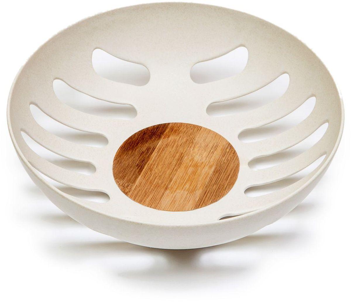 Фруктовница MOULINvilla, цвет: белый, 21,8 х 21,8 х 6,3 смVT-1520(SR)Фруктовница MOULINvilla, изготовленная из природного бамбука, очищенного от вредных примесей идеально подходит для хранения и красивой сервировки любых фруктов. Для окраски используются натуральные пищевые красители. Бамбук, сам по себе, является природным антисептиком. Эта уникальная особенность посуды гарантирует безопасность при эксплуатации и хранении различных видов пищевой продукции. Можно мыть в посудомоечной машине.