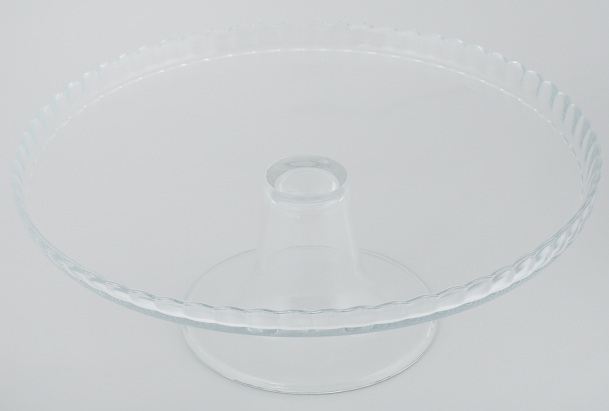 Блюдо на ножке Pasabahce Patisserie, диаметр 28 см. 98259BV115610Блюдо на ножке Pasabahce Patisserie, выполненное из высококачественного стекла, оригинально украсит праздничный стол и поможет красиво расположить торт или пирог. Блюдо с рифлеными краями установлено на изящную ножку. Функциональность и эстетичность блюда Pasabahce Patisserie порадует любую хозяйку.