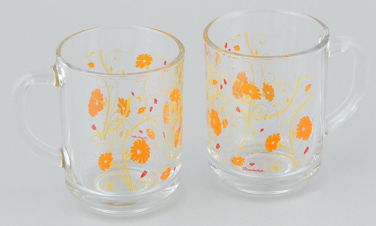 Набор кружек Pasabahce Workshop Serenade, цвет: прозрачный, оранжевый, 250 мл, 2 шт115510Набор Pasabahce Workshop Serenade состоит из двух кружек с удобными ручками, выполненных из прочного натрий-кальций-силикатного стекла. Кружки декорированы ярким изображением. Изделия хорошо удерживают тепло, не нагреваются. На них не выгорает и не вымывается рисунок. Посуда Pasabahce Workshop будет радовать вас яркими, интересными рисунками и качеством изготовления. Объем кружки: 250 мл.