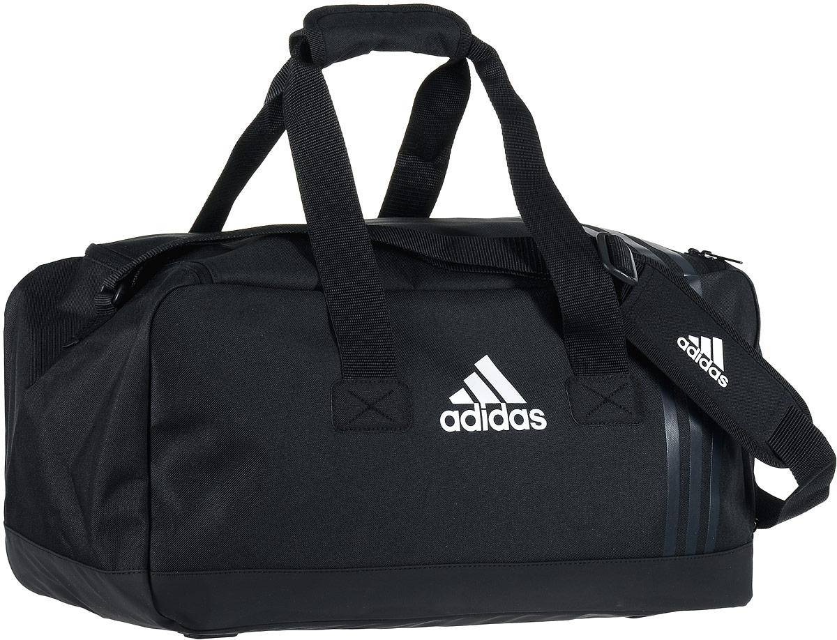 Сумка спортивная Adidas Tiro TB, цвет: черный, 48 х 24 х 24 смBM8434-58AEСтильная спортивная сумка Adidas Tiro TB выполнена из полиэстера и полиэфира. Изделие имеет одно отделение, закрывающееся на застежку-молнию. Основание изделия выполнено из более плотного материала с полиуретановым покрытием, что обеспечивает защиту от влаги и дополнено пластиковыми ножками. Снаружи, с одной из боковых сторон сумка имеет карман для обуви на застежке-молнии. Сумка оснащена двумя удобными ручками для переноски в руках и регулируемым наплечным ремнем с мягкой подушечкой.