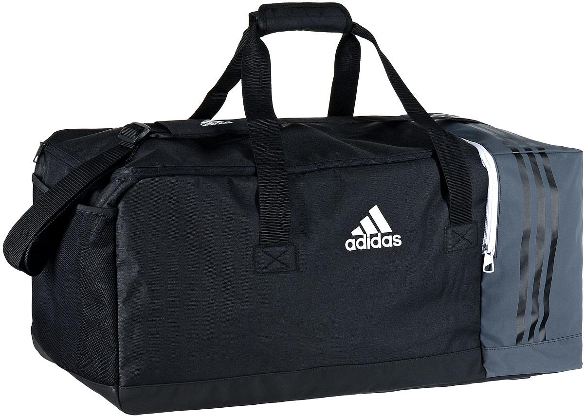 Сумка спортивная Adidas Tiro TB, цвет: черный, темно-серый, 70 х 32 х 31 смL39845800Стильная спортивная сумка Adidas Tiro TB выполнена из полиэстера и полиэфира. Изделие имеет одно отделение, закрывающееся на застежку-молнию. Внутри расположены два накладных открытых кармана и нашивной карман на застежке-молнии. Снаружи, с одной из боковых сторон находится вентилируемый карман для обуви на застежке-молнии, с другой стороны - сетчатый карман. Основание изделия выполнено из более плотного материала с полиуретановым покрытием, что обеспечивает защиту от влаги и дополнено пластиковыми ножками. Сумка оснащена двумя удобными ручками для переноски в руках и регулируемым наплечным ремнем.