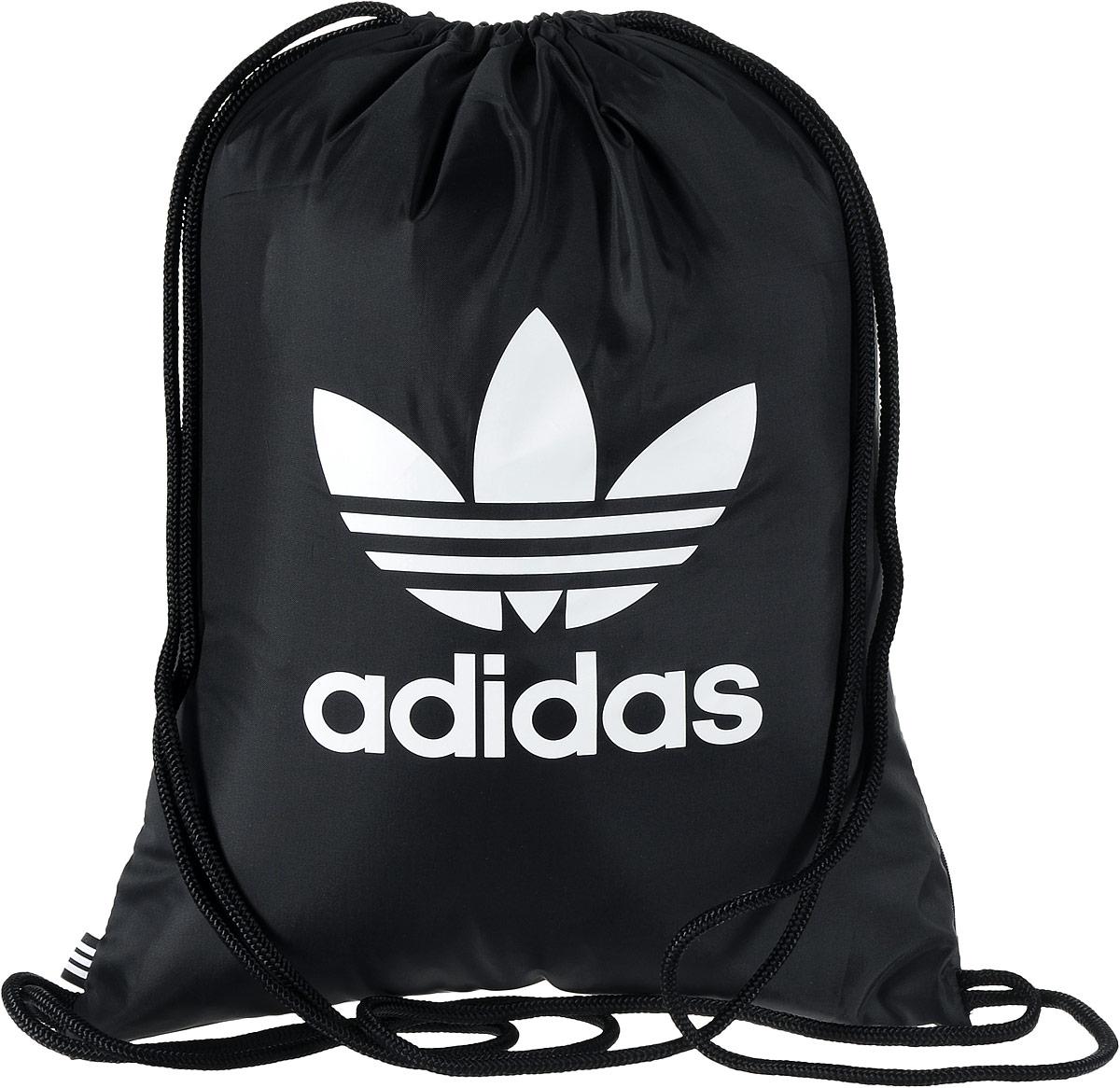Рюкзак спортивный Adidas Trefoil, цвет: черный, 23 л. BK6726ГризлиСтильный спортивный рюкзак Adidas Trefoil выполнен из полиэстера и оформлен символикой бренда. Изделие имеет одно основное отделение, которое закрывается с помощью затягивающего шнурка.С внутренней стороны изделие оснащено удобной ручкой для переноски. Снаружи, с одной из боковых сторон находится прорезной карман на застежке-молнии. Веревочные завязки можно использовать как наплечные лямки. Стильный и функциональный рюкзак поместит все необходимое.