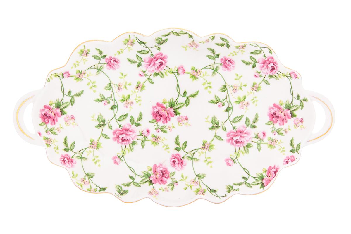Блюдо для нарезки Elan Gallery Плетистая роза, 26 х 14 х 2,5 см740343Блюдо для нарезки Elan Gallery Плетистая роза, изготовленное из фарфора, прекрасно подойдет для подачи нарезок, закусок и других блюд. Блюдо дополнено двумя удобными ручками и оформлено цветочным рисунком. Такое блюдо украсит сервировку вашего стола и подчеркнет прекрасный вкус хозяйки. Не рекомендуется применять абразивные моющие средства. Не использовать в микроволновой печи.Размер блюда по верхнему краю: 26 х 14 см.Высота блюда: 2,5 см