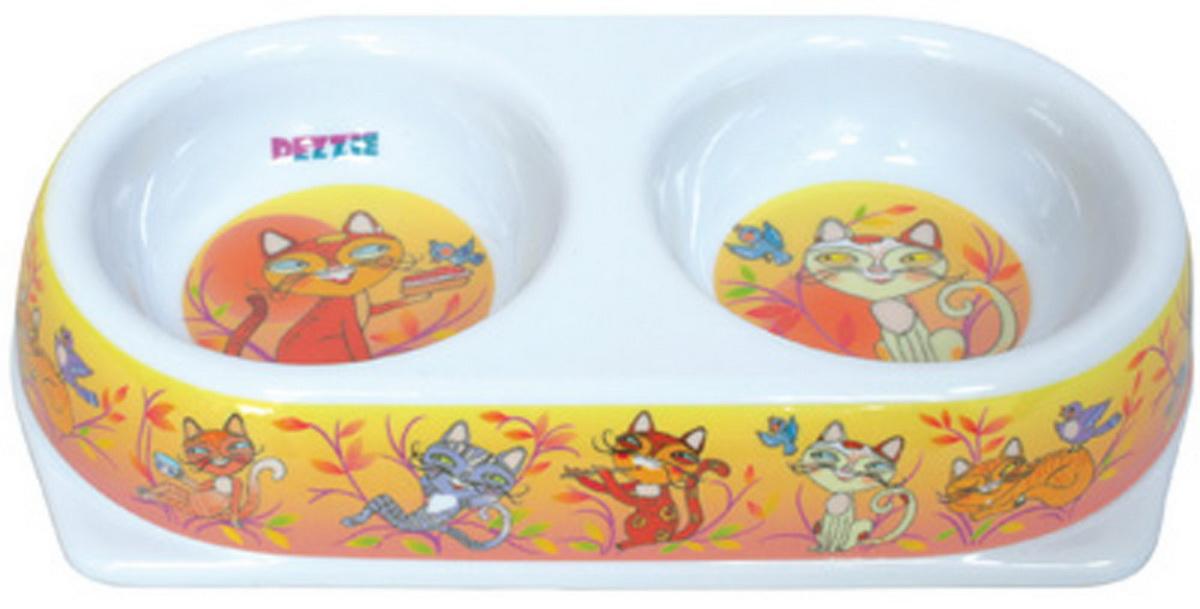 Миска для кошек Dezzie Мечта, двойная, 2 х 180 мл3168Двойная миска для кошек Dezzie Мечта, выполненная из пластика и оформленная красочным изображением,отличается легкостью и удобством применения. Она легко моется и быстро высыхает. Миска имеет резиновые антискользящие вставки.Размер миски: 25 x 13,5 x 5 см. Объем миски: 2 х 180 мл.