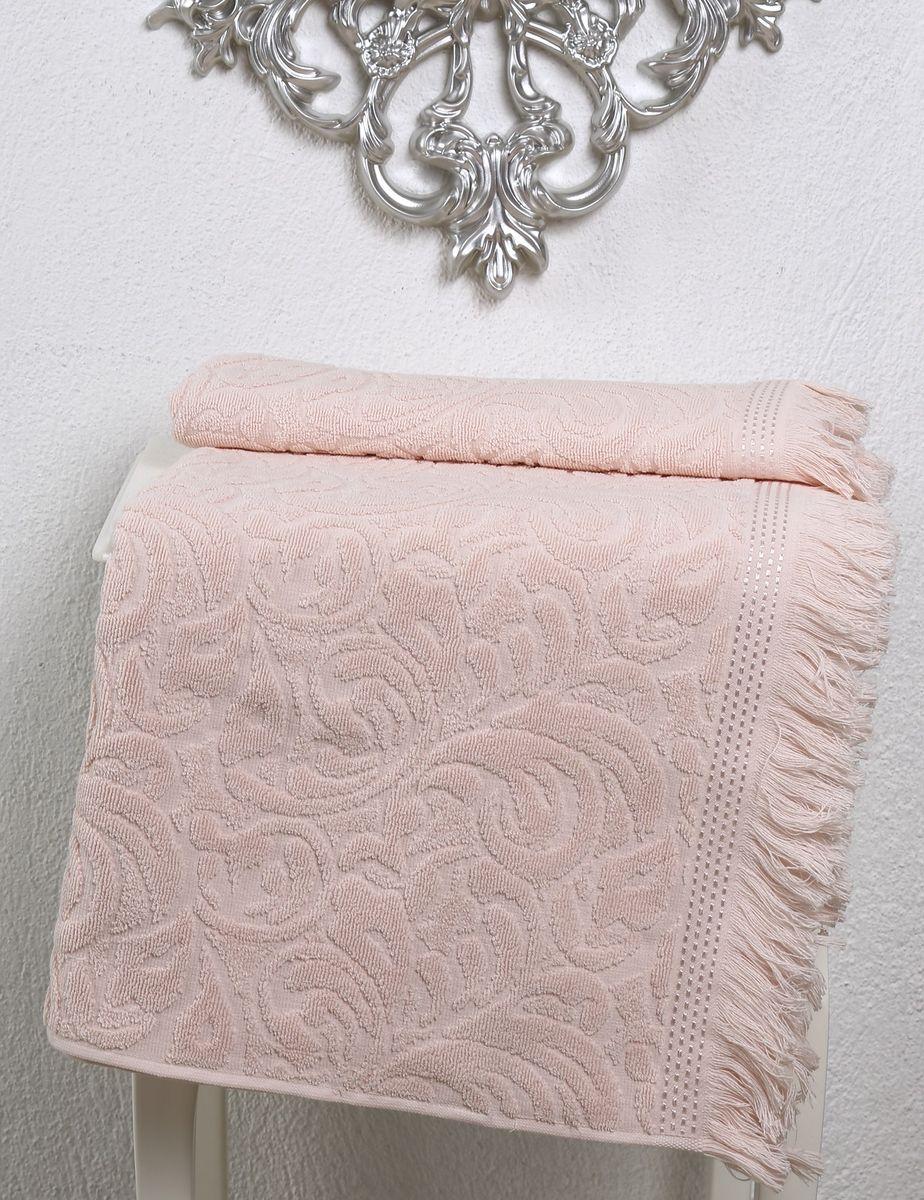 Полотенце Karna Esra, цвет: абрикосовый, 50 х 90 см2194/CHAR002Полотенце махровое Karna изготавливают из высококачественных хлопковых нитей. Хлопковые нити прядутся из длинных волокон. Длина волокон хлопковой нити влияет на свойства ткани, чем длиннее волокна, тем махровое изделие прочнее, пушистее и мягче на ощупь. А также махровое изделие будет отлично впитывать воду и быстро сохнуть. На впитывающие качества махры (ее гигроскопичность), конечно же, влияет состав волокон. Махра абсолютно не аллергена, имеет высокую воздухопроницаемость и долгий срок использования ткани.Отличительной особенностью данной модели является её оригинальный рисунок (вышивка) и подарочная упаковка. Декор в виде вышивки и бахромы хорошо смотрится. Вышитые изображения отличаются своей долговечностью и практичностью, они не выгорают и не линяют.