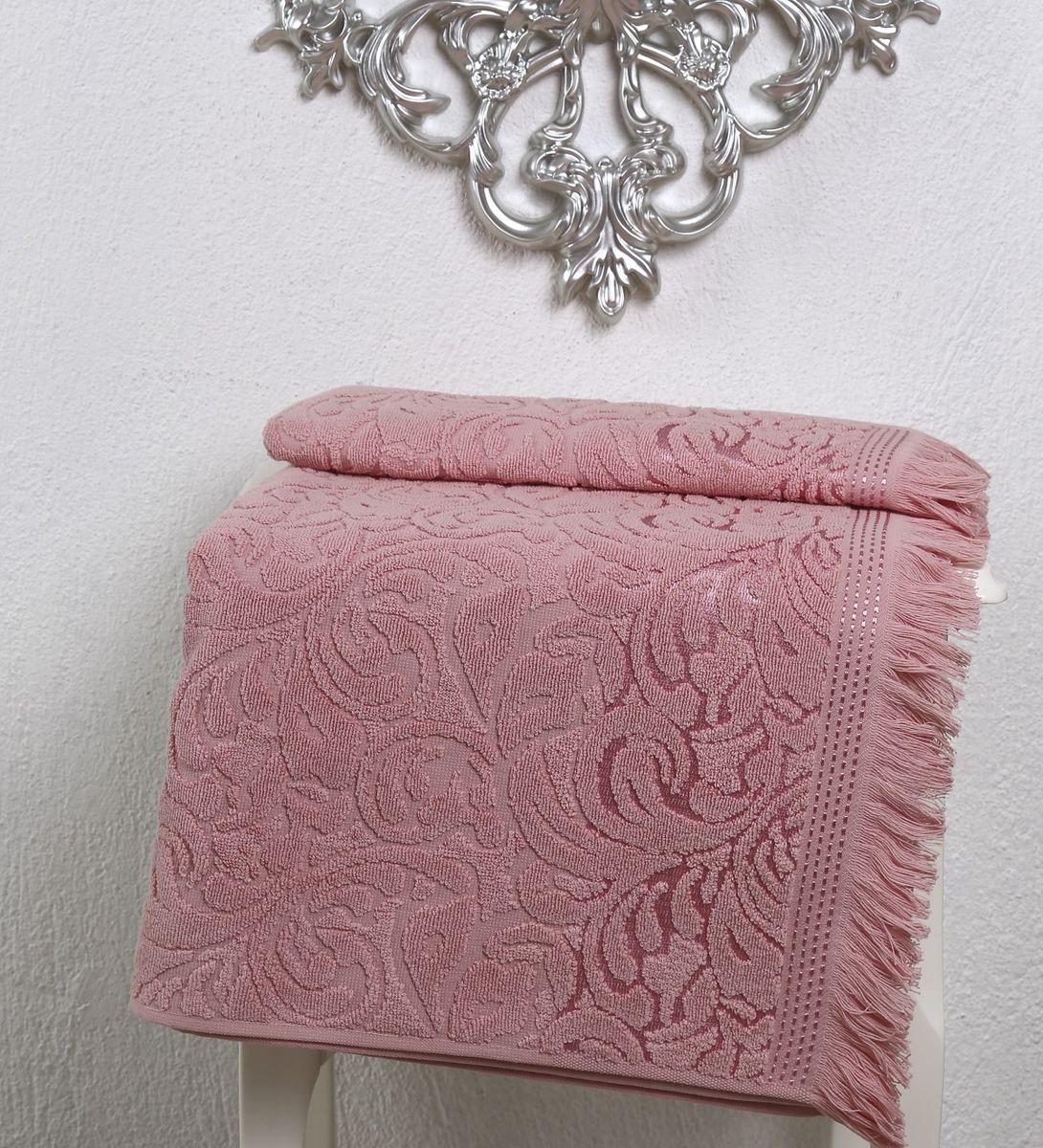 Полотенце Karna Esra, цвет: розовый, 70 х 140 см2195/CHAR006Полотенце махровое Karna изготавливают из высококачественных хлопковых нитей. Хлопковые нити прядутся из длинных волокон. Длина волокон хлопковой нити влияет на свойства ткани, чем длиннее волокна, тем махровое изделие прочнее, пушистее и мягче на ощупь. А также махровое изделие будет отлично впитывать воду и быстро сохнуть. На впитывающие качества махры (ее гигроскопичность), конечно же, влияет состав волокон. Махра абсолютно не аллергена, имеет высокую воздухопроницаемость и долгий срок использования ткани.Отличительной особенностью данной модели является её оригинальный рисунок (вышивка) и подарочная упаковка. Декор в виде вышивки и бахромы хорошо смотрится. Вышитые изображения отличаются своей долговечностью и практичностью, они не выгорают и не линяют.
