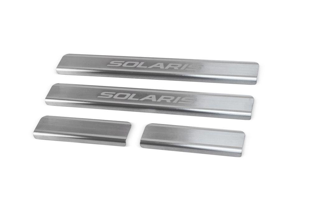 """Накладки на пороги Rival для Hyundai Solaris 2011-, 4 штSVC-300Накладки на пороги RIVALНакладки на пороги создают индивидуальный интерьер автомобиля и защищают лакокрасочное покрытие от механических повреждений- Использование высококачественной итальянской нержавеющей стали AISI 304.- Надежная фиксация на автомобиле с помощью """"фирменного"""" скотча 3М.- Устойчивое к истиранию изображение на накладках нанесено методом абразивной полировки.- Идеально повторяют геометрию порогов автомобиля.Уважаемые клиенты! Обращаем ваше внимание,что накладки имеют форму и комплектацию, соответствующую модели данного автомобиля. Фото служит для визуального восприятия товара."""