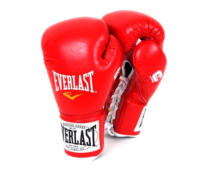 Перчатки боевые Everlast 1910 Fight, цвет: красный, вес 10 унцийSF 0085Классическая модель перчаток Everlast 1910 Fight создана специально для поединков на профессиональном ринге с учетом всех регламентов и требований, предъявляемых к такой экипировке. Выполнены из натуральной кожи. Набивка из многослойного пенного наполнителя обеспечивает достаточно высокий уровень защиты рук спортсмена и снижает жесткость перчаток. Удобное положение руки в перчатке не требует усилий для сжатия кулака, что позволит вам наносить более жесткие удары при меньших энергозатратах. Данные перчатки прошли сертификацию и получили одобрение к использованию от всех американских и Международных боксерских организаций и федераций включая WBC, IBO, WBA, WBO и IBF.