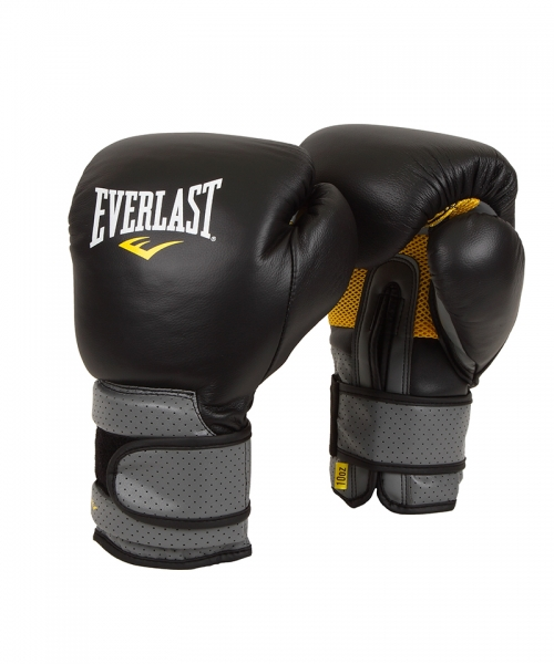 Боксерские перчатки Everlast Pro Leather Strap, цвет: черный. Вес 16 унций691601Everlast Pro Leather Strap - тренировочные боксерские перчатки, разработанные и изготовленные с применением новейших технологий. Уникальный пенный наполнитель C3 Foam™ превосходно амортизирует даже самые мощные удары, гарантируя безопасность во время тренировок. Материал-сетка на ладони вкупе с технологией EverCool™ обеспечивают отличную вентиляцию и позволяют руке дышать. В то же время, технология EverDri™ активно борется с потом, уничтожая излишки влаги и плохой запах. Перчатки изготовлены из высококачественной натуральной кожи, что дает им солидный запас прочности и отличную износостойкость, а застежка-липучка позволяет подогнать их точно по руке, плотно зафиксировав запястье. Тренировочные боксерские перчатки Everlast Pro Leather Strap предназначены для спаррингов, работы с тяжелыми мешками и лапами.