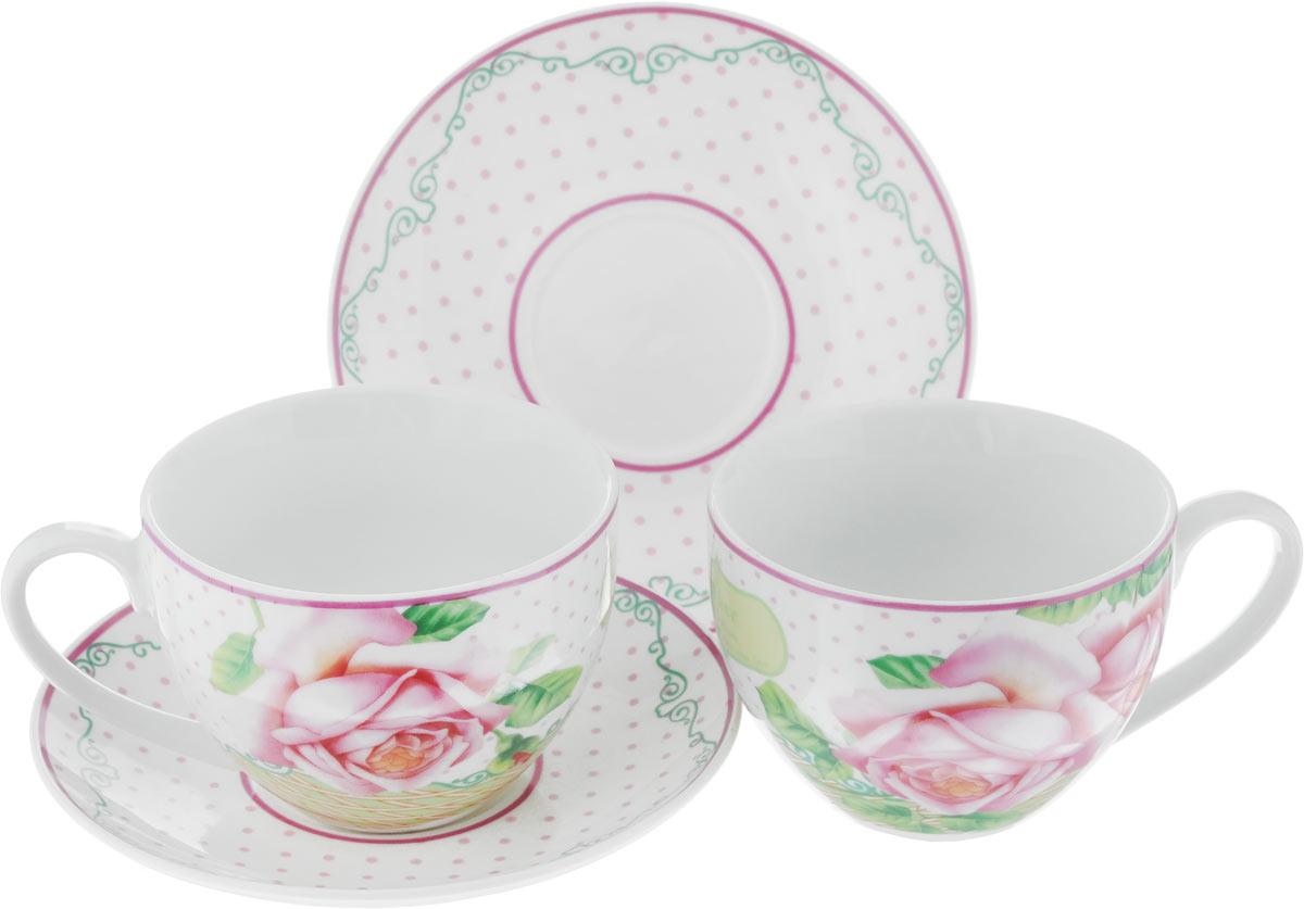 Набор чайный Loraine Розы, цвет: розовый, зеленый, 4 предмета22999Чайный набор Loraine Розы, выполненный из керамики, состоит из 2 чашек и 2 блюдец. Предметы набора имеют яркую расцветку. Изящный дизайн и красочность оформления придутся по вкусу и ценителям классики, и тем, кто предпочитает современный стиль. Чайный набор - идеальный и необходимый подарок для вашего дома и для ваших друзей в праздники, юбилеи и торжества! Он также станет отличным корпоративным подарком и украшением любой кухни. Чайный набор упакован в подарочную коробку из плотного цветного картона. Внутренняя часть коробки задрапирована белым атласом.Диаметр кружки (по верхнему краю): 9 см.Высота стенки: 6,5 см.Диаметр блюдца: 14 см.Высота блюдца: 2 см.Объем чашки: 220 см.