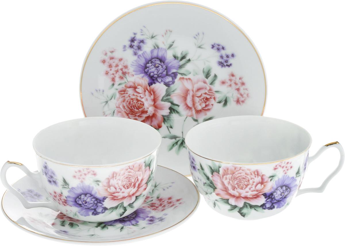 Набор чайный Loraine, 4 предмета. 24596DFC03902/03811-02253 5/SЧайный набор Loraine состоит из двух чашек и двух блюдец. Изделия, выполненные из высококачественной керамики, имеют элегантный дизайн и декорированы изображением цветов. Такой набор прекрасно подойдет как для повседневного использования, так и для праздников. Чайный набор упакован в подарочную коробку из плотного цветного картона. Внутренняя часть коробки задрапирована белым атласом.Чайный набор Loraine - это не только яркий и полезный подарок для родных и близких, это также великолепное дизайнерское решение для вашей кухни или столовой. Объем чашки: 250 мл. Диаметр чашки (по верхнему краю): 9,5 см. Высота чашки: 6 см.Диаметр блюдца: 15 см.Высота блюдца: 1,7 см.