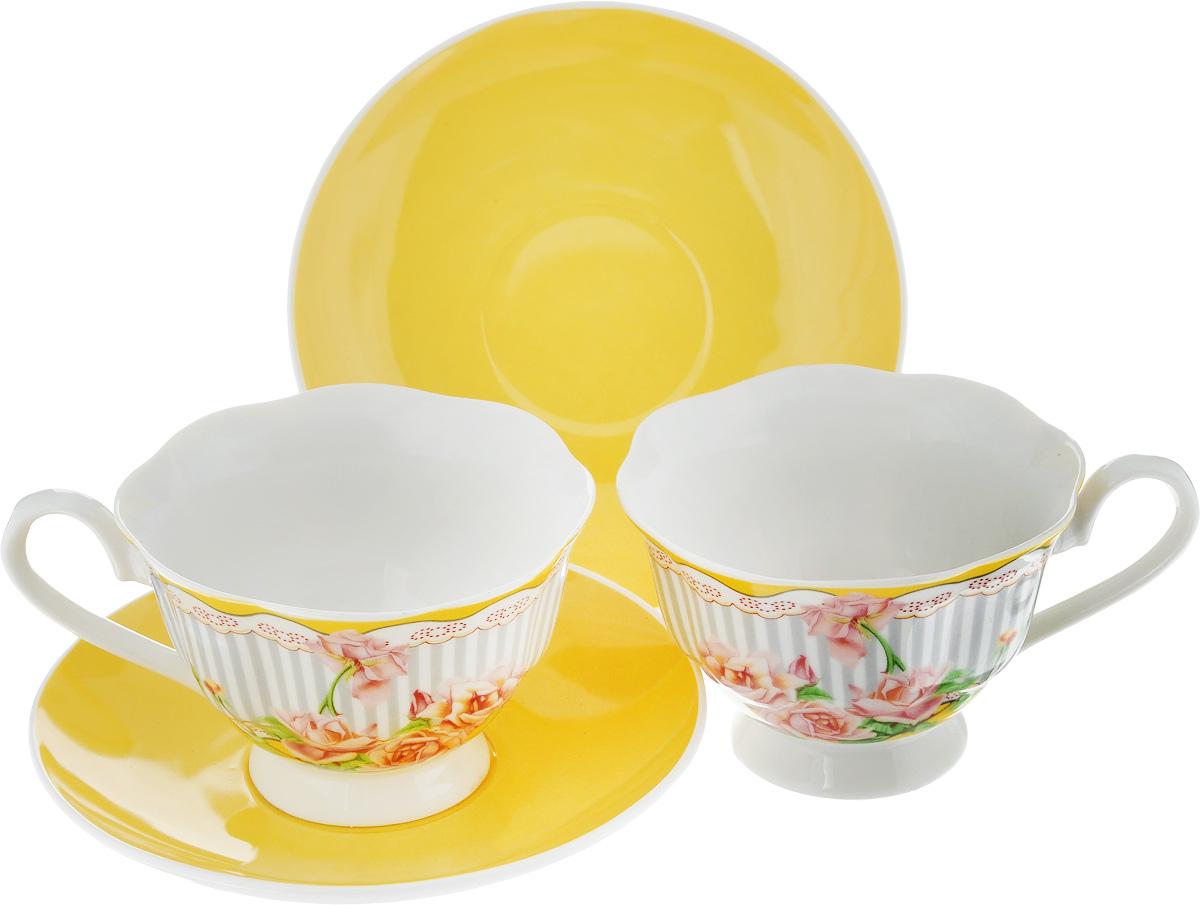 Набор чайный Loraine Садовые розы, цвет: желтый, серый, зеленый, 4 предмета. 2300123001Чайный набор Loraine Садовые розы, выполненный из керамики, состоит из 2 чашек и 2 блюдец. Предметы набора имеют яркую расцветку. Изящный дизайн и красочность оформления придутся по вкусу и ценителям классики, и тем, кто предпочитает современный стиль. Чайный набор - идеальный и необходимый подарок для вашего дома и для ваших друзей в праздники, юбилеи и торжества! Он также станет отличным корпоративным подарком и украшением любой кухни. Чайный набор упакован в подарочную коробку из плотного цветного картона. Внутренняя часть коробки задрапирована белым атласом.Размер кружки (по верхнему краю): 9,5 х 9 см.Высота стенки: 6,5 см.Диаметр блюдца: 14,2 см.Высота блюдца: 2 см.Объем чашки: 200 см.