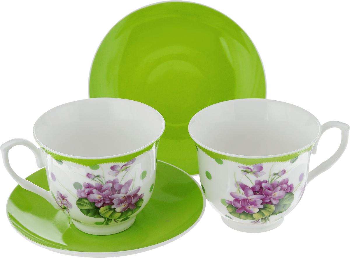 Набор чайный Loraine Лютик, цвет: белый, фиолетовый, зеленый, 4 предмета115510Чайный набор Loraine Лютик, выполненный из керамики, состоит из 2 чашек и 2 блюдец. Предметы набора имеют яркую расцветку. Изящный дизайн и красочность оформления придутся по вкусу и ценителям классики, и тем, кто предпочитает современный стиль. Чайный набор - идеальный и необходимый подарок для вашего дома и для ваших друзей в праздники, юбилеи и торжества! Он также станет отличным корпоративным подарком и украшением любой кухни. Чайный набор упакован в подарочную коробку из плотного цветного картона. Внутренняя часть коробки задрапирована белым атласом.Диаметр кружки (по верхнему краю): 9 см.Высота стенки: 7,5 см.Диаметр блюдца: 14,2 см.Высота блюдца: 2 см.Объем чашки: 220 см.